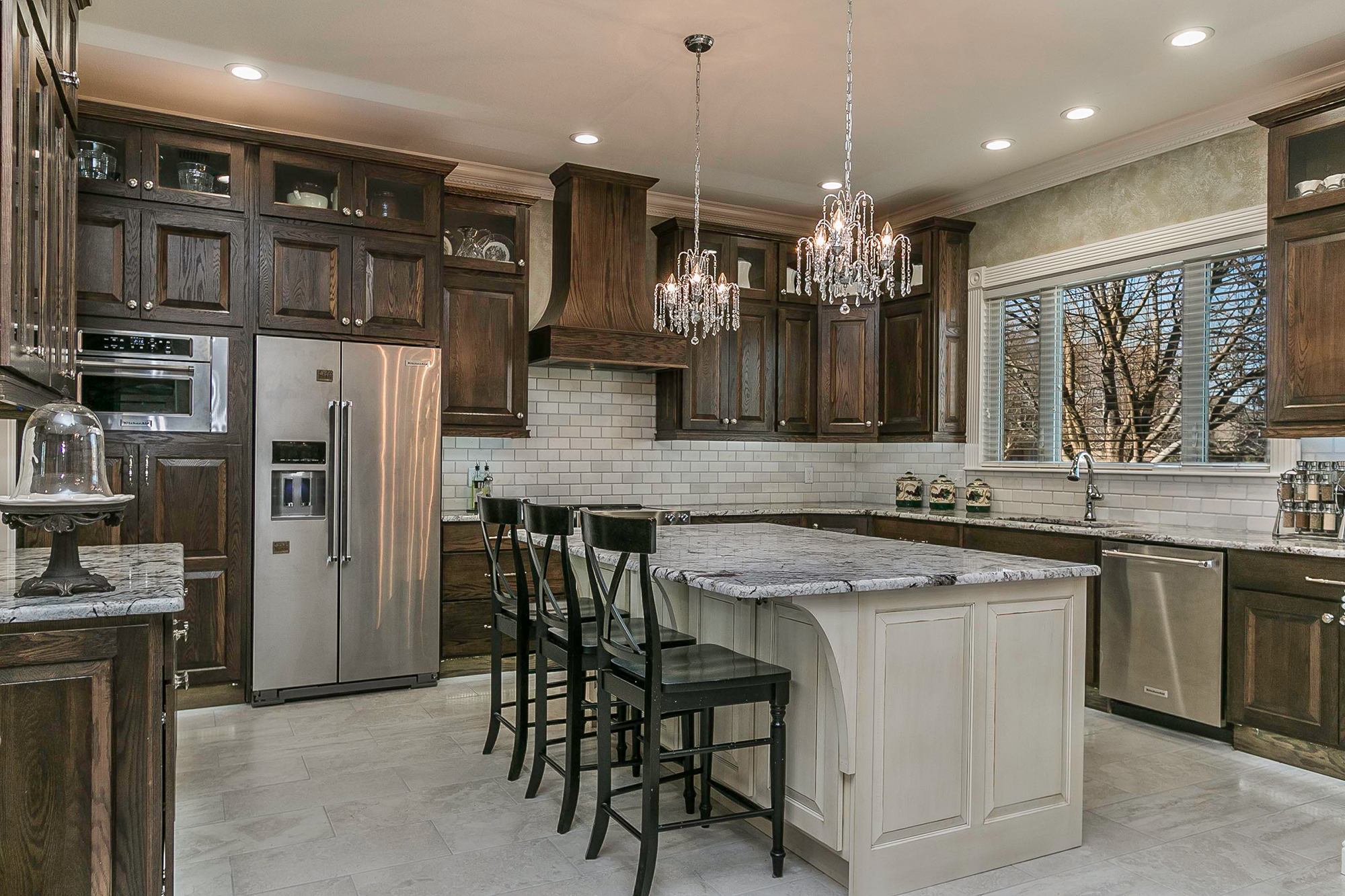 Stained kitchen cabinets in oak Tawny with island in paint grade Dover White by Showplace Cabinetry-View 3