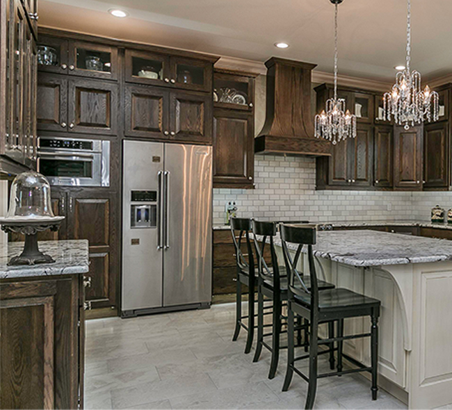 Stained kitchen cabinets in oak Tawny with island in paint grade Dover White by Showplace Cabinetry-View 2
