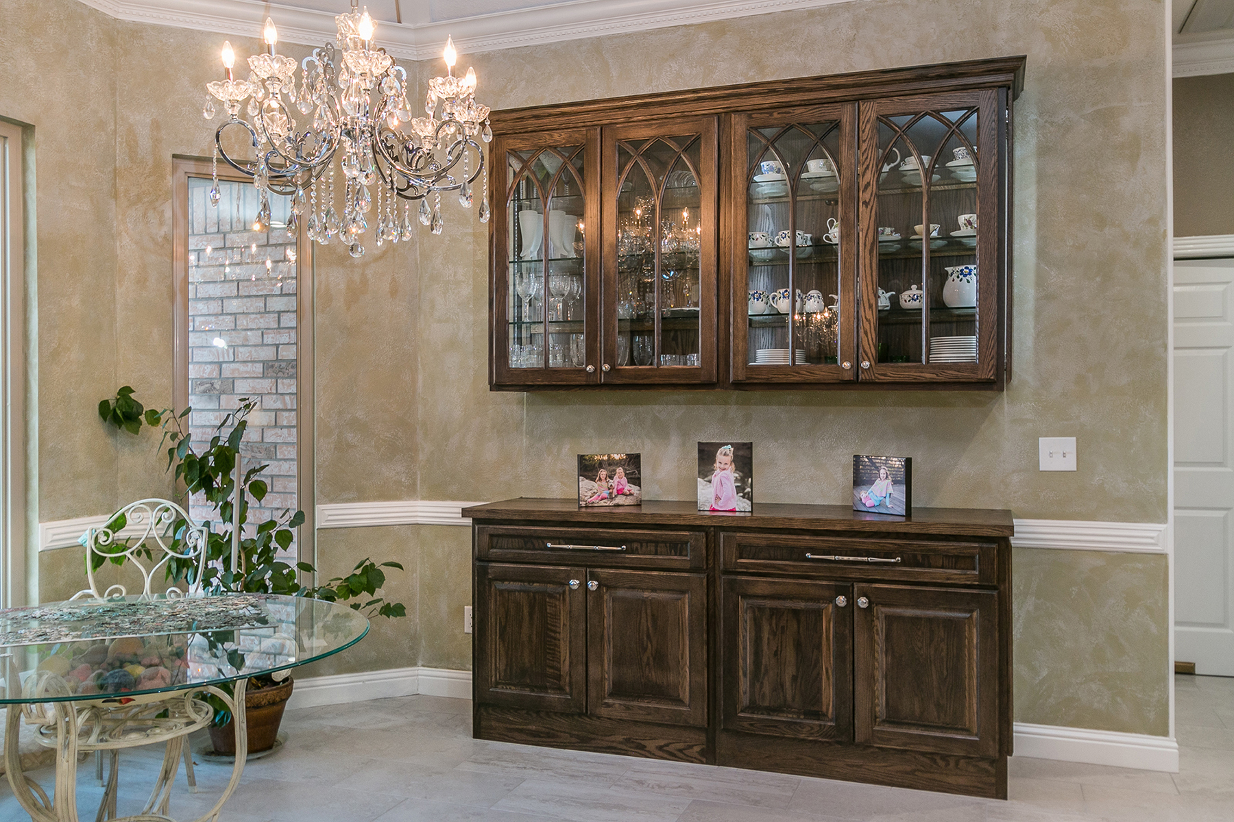 Stained dining room cabinets in oak Tawny by Showplace Cabinetry-View 1