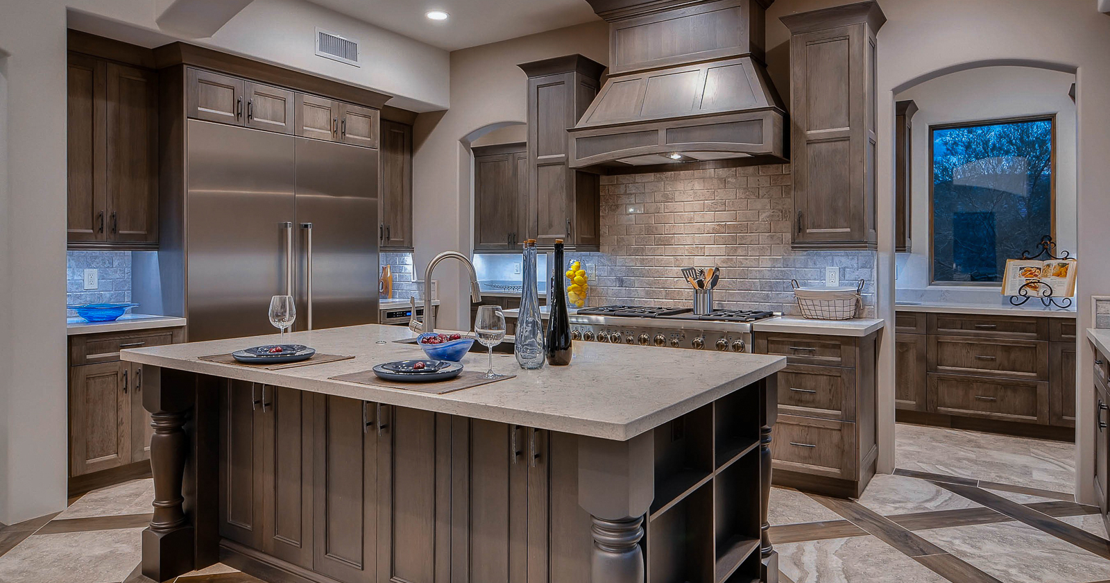 The Sutherland and Savannah door styles are mixed in this gray stained Showplace kitchen