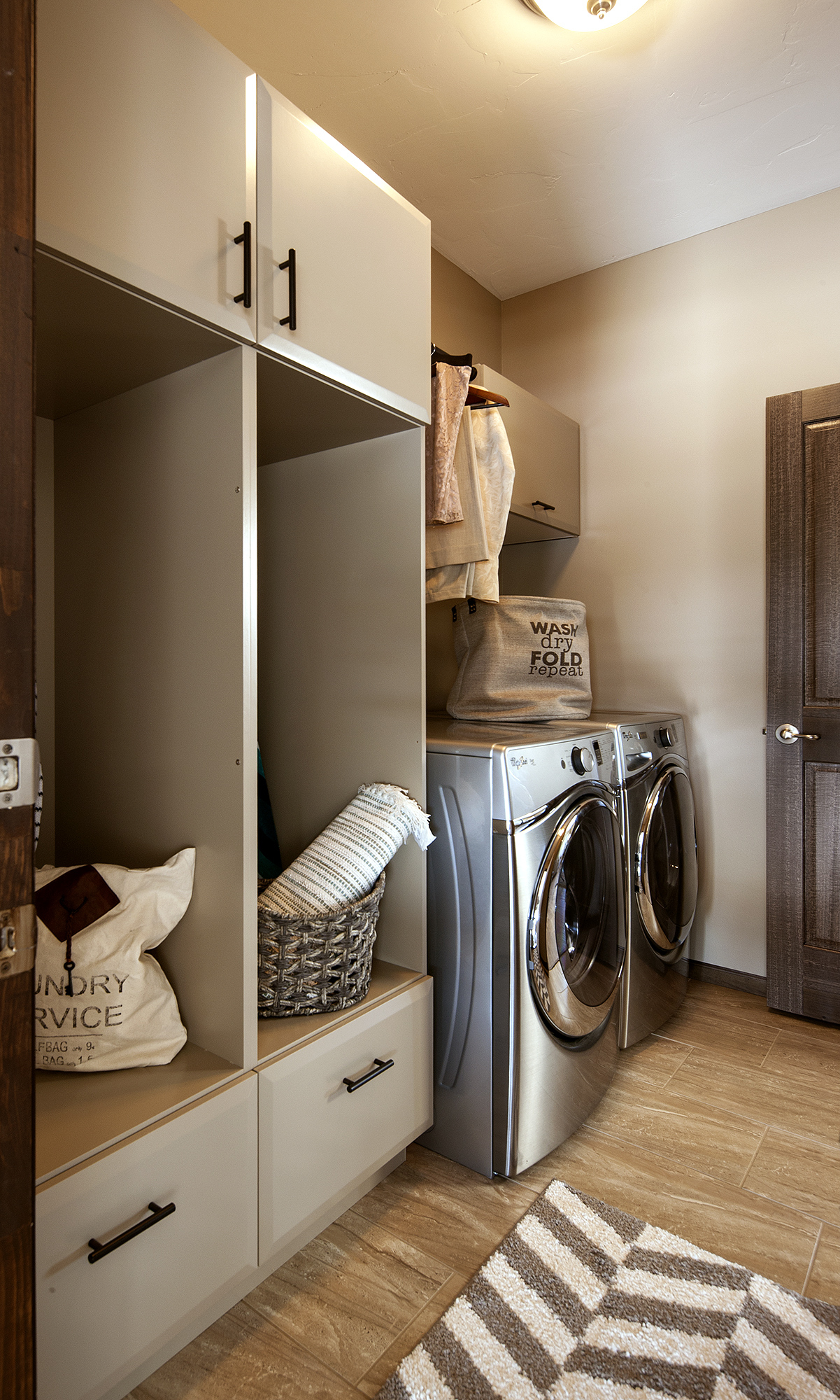 Painted Laundry Cabinets in Sandstone by ShowplaceEVO