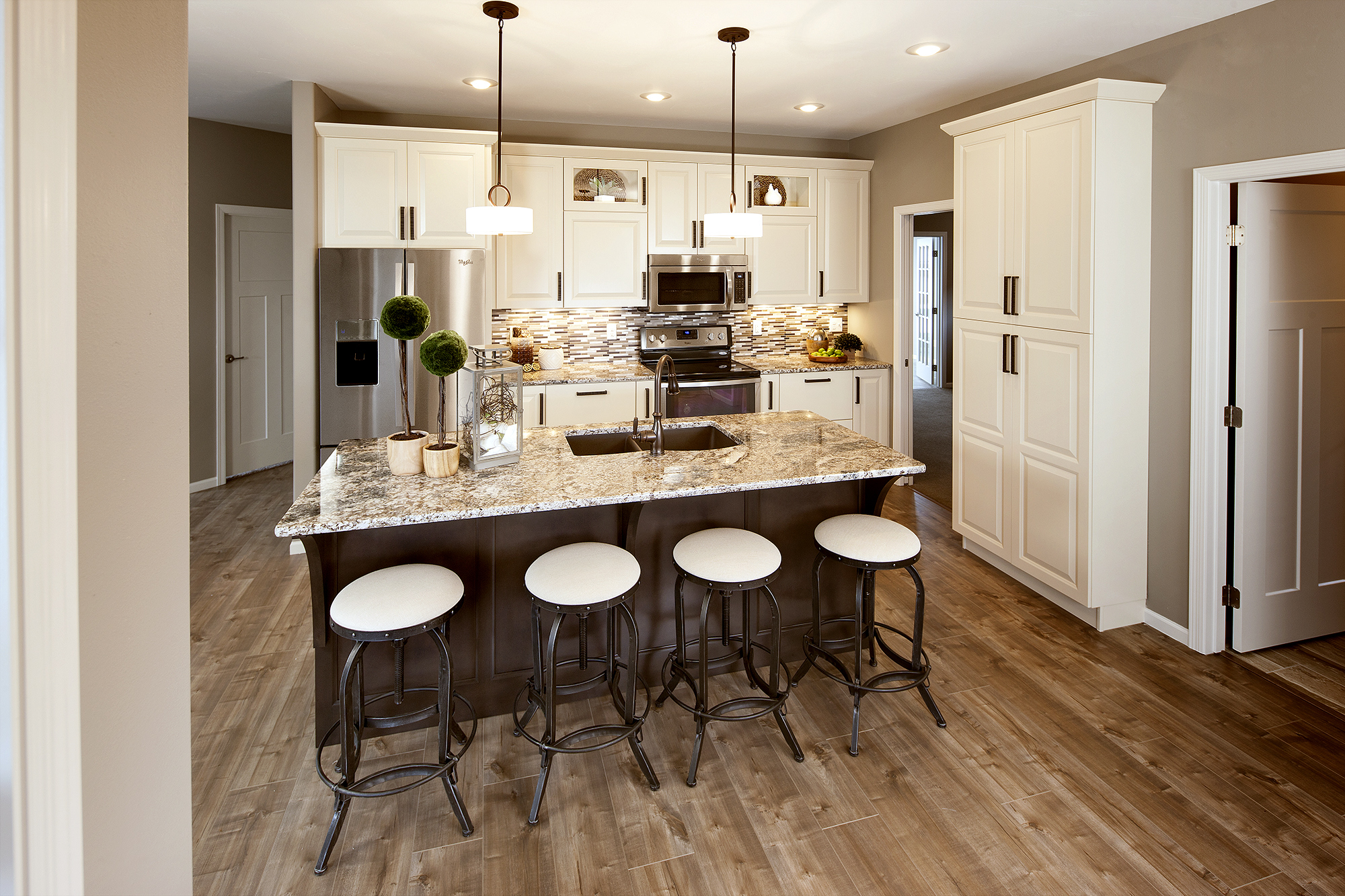 Painted Kitchen Cabinets in Moderate White and Stained Island in Peppercorn by ShowplaceEVO - View 1