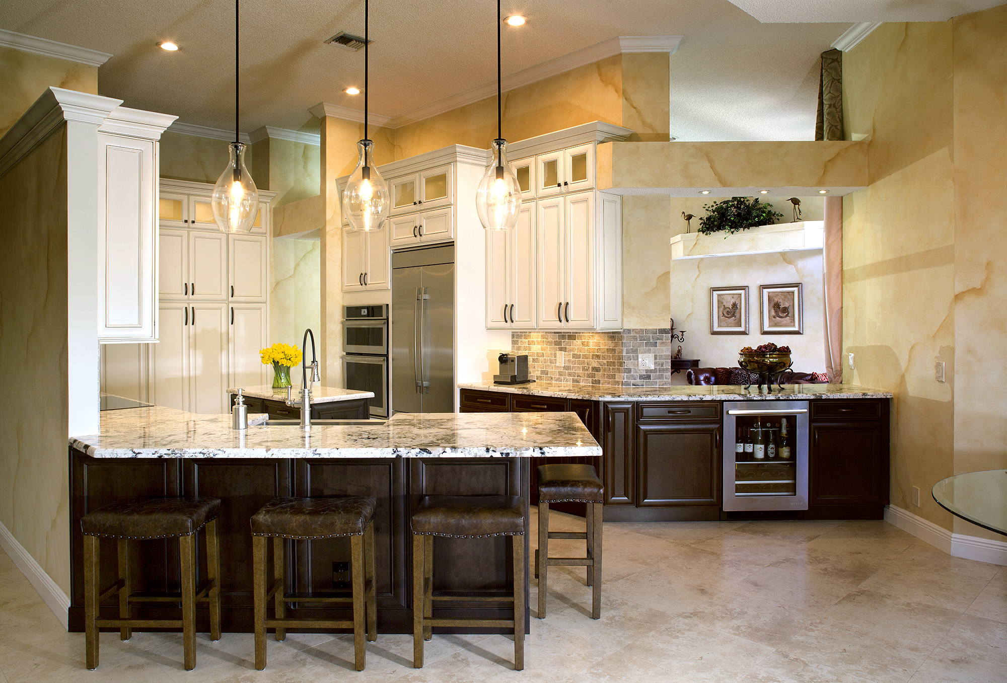 Painted Kitchen Cabinets in Soft Cream with Ebony Glaze and Stained Kitchen Cabinets in Espresso by Showplace Cabinetry