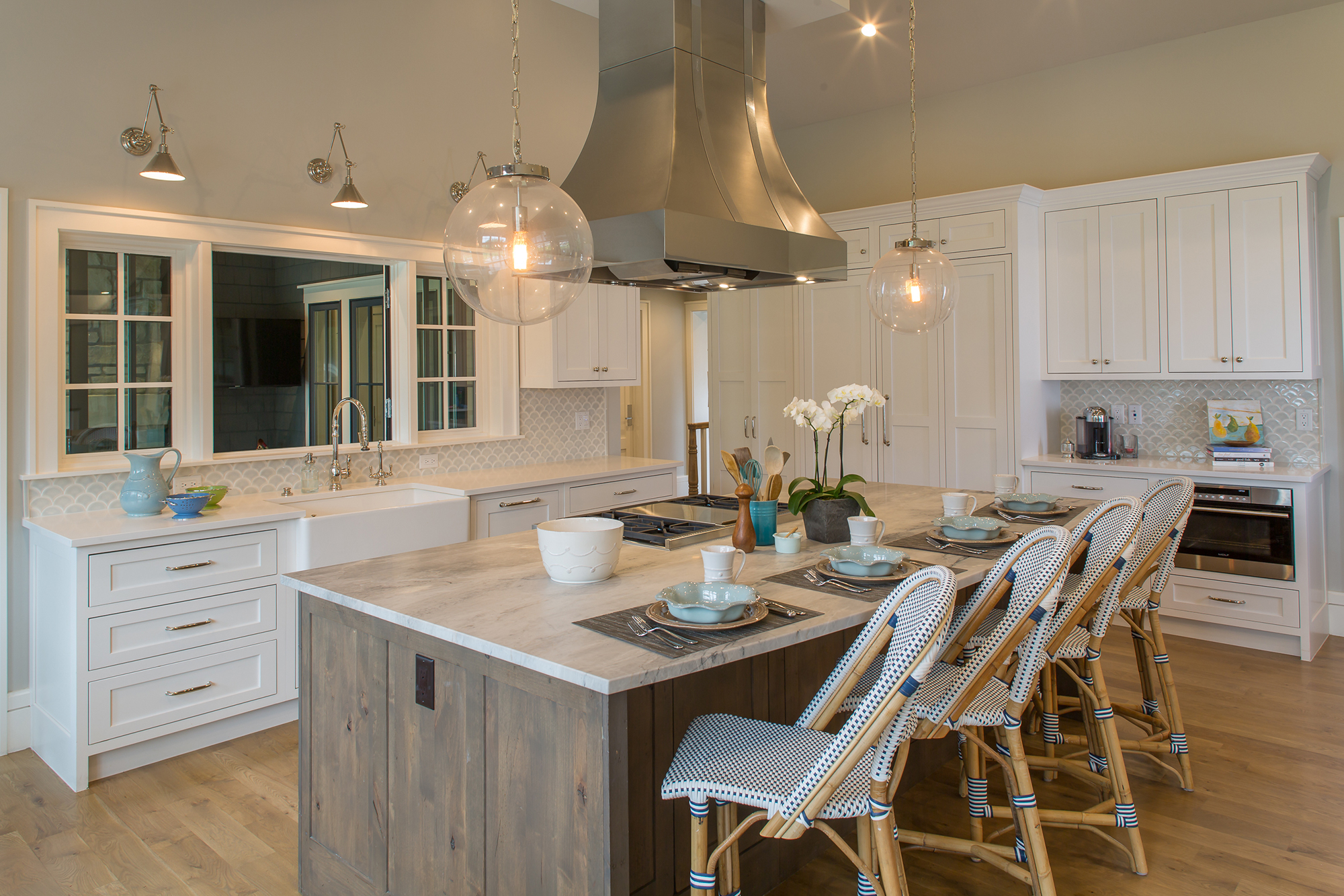 Painted Kitchen cabinets in White and Stained Kitchen Island in Driftwood by Showplace Cabinetry - View 1