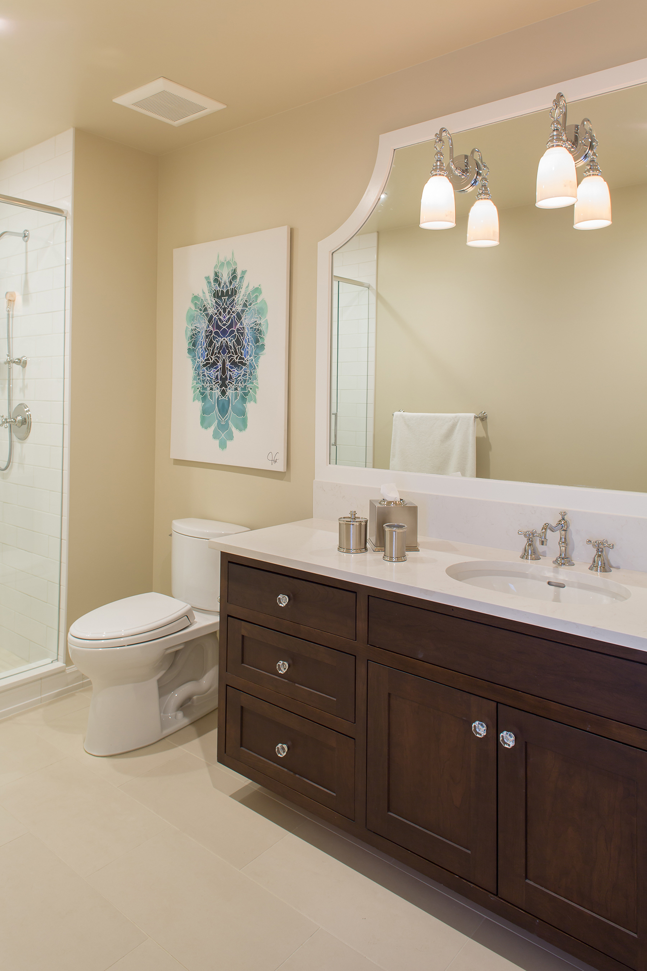 Stained Guest Bathroom Cabinets in Coffee by Showplace Cabinetry
