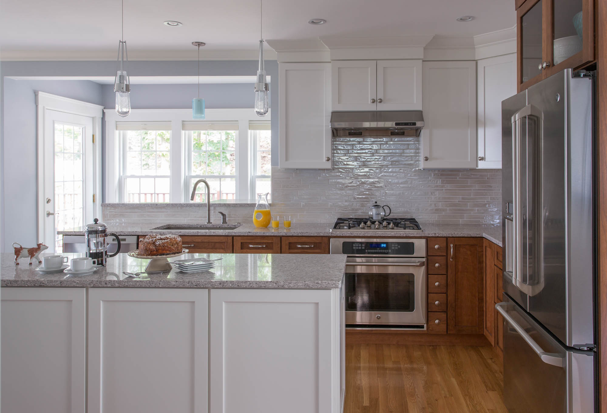 Painted kitchen wall and island in White by Showplace Cabinetry
