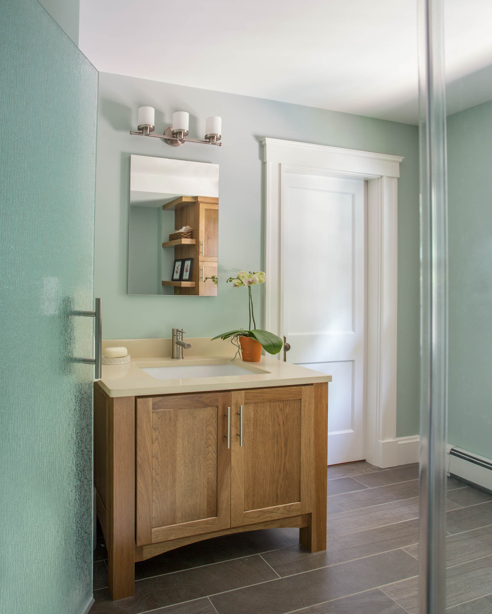 Stained master bathroom vanity in Cognac by Showplace Cabinetry