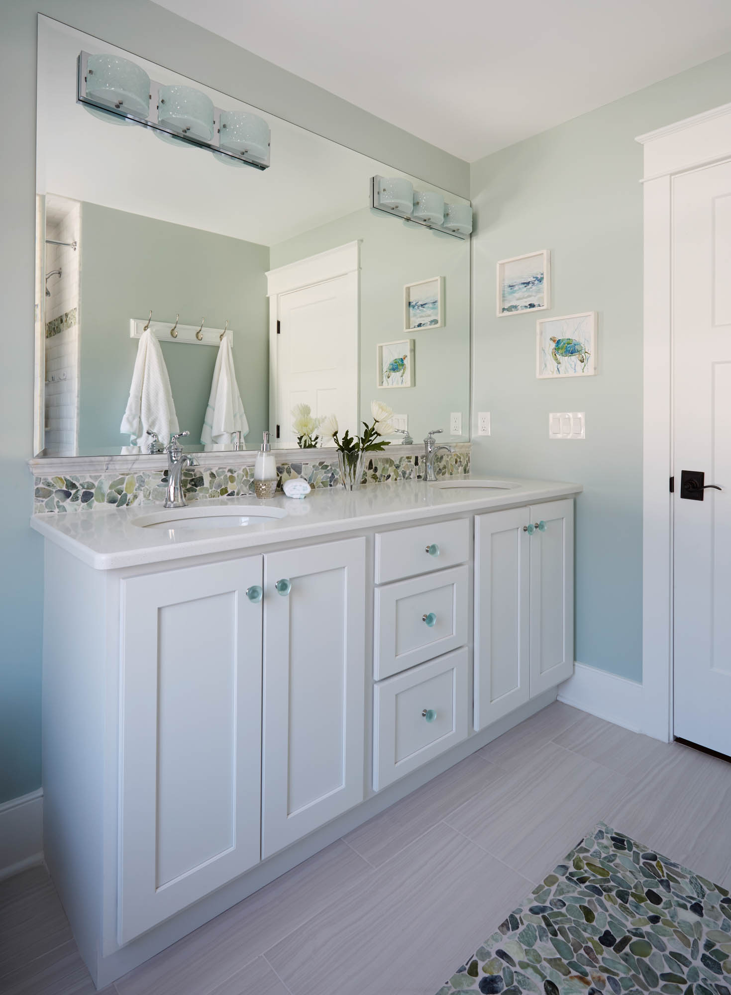 Painted guest bathroom vanity in Extra White by Showplace Cabinetry - view 1