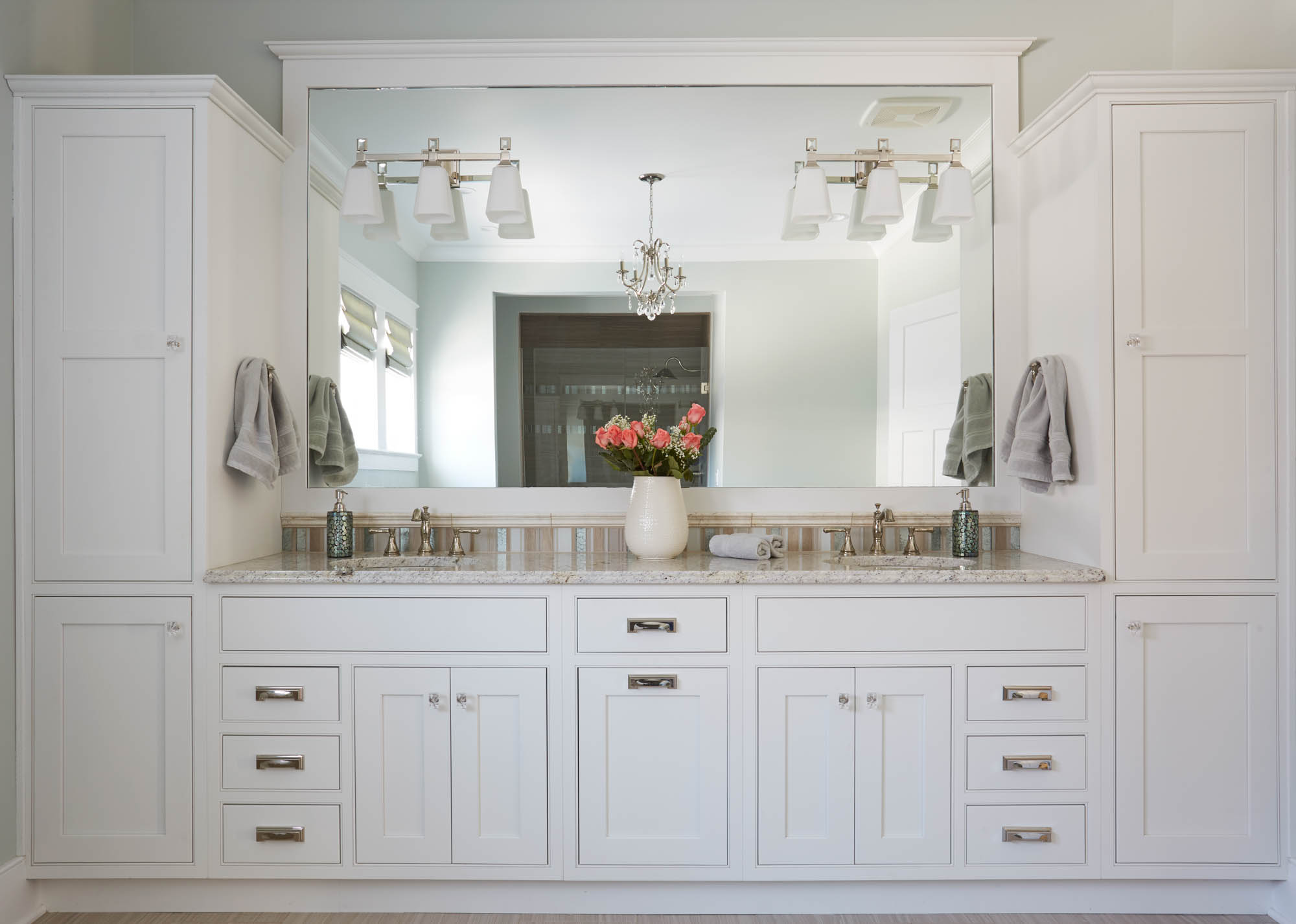 Painted master bathroom cabinets in Extra White by Showplace Cabinetry