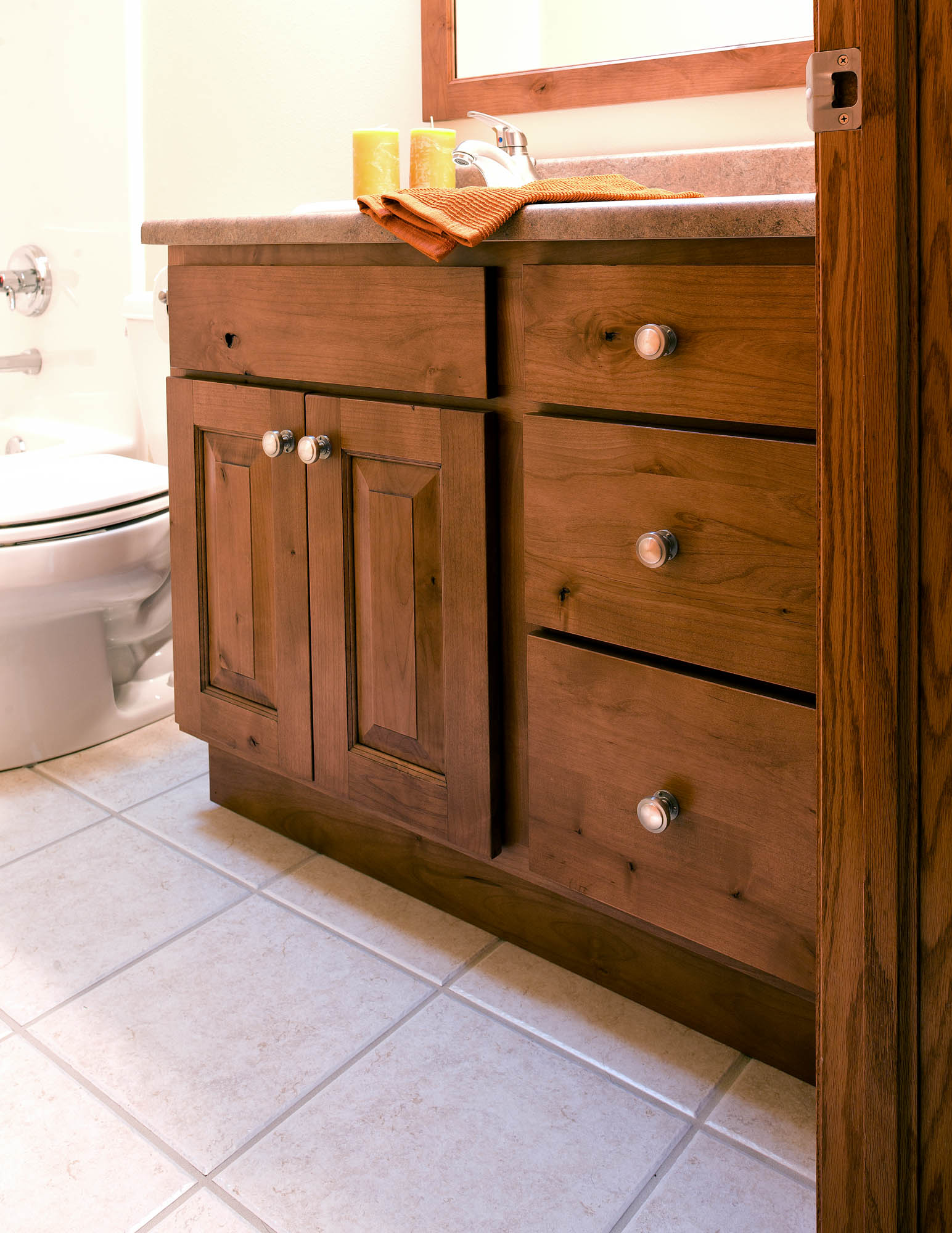 Renew | Stained bathroom vanity in Nutmeg with Ebony Glaze by Showplace Cabinetry