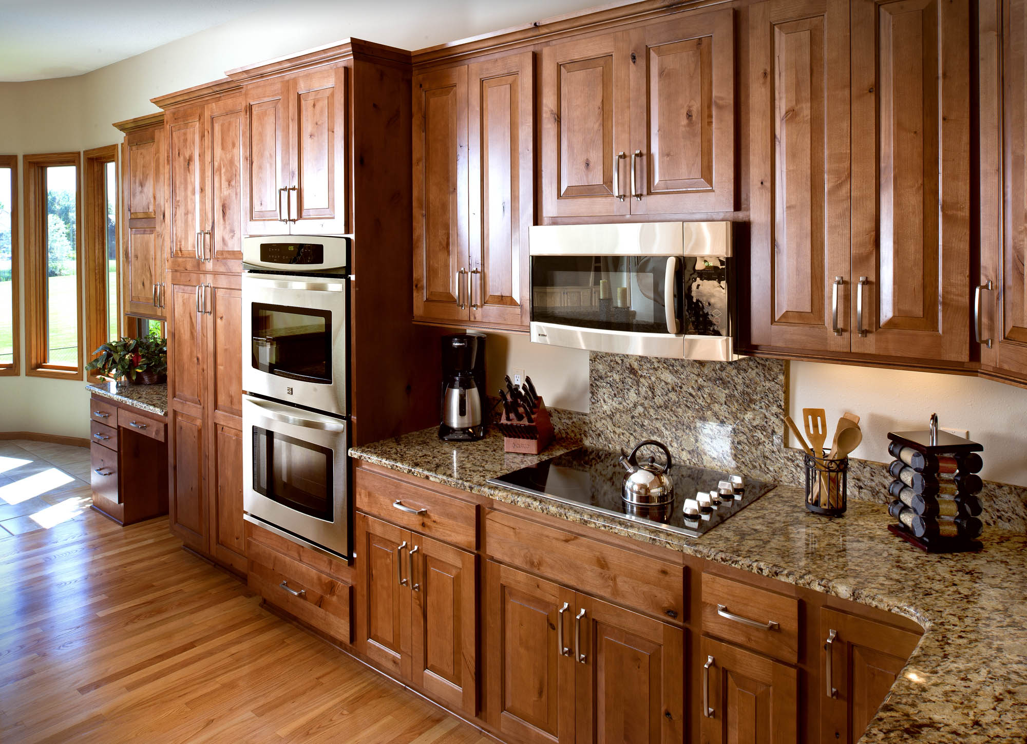 Renew | Stained kitchen cabinets in Nutmeg with Ebony Glaze by Showplace Cabinetry - view 2