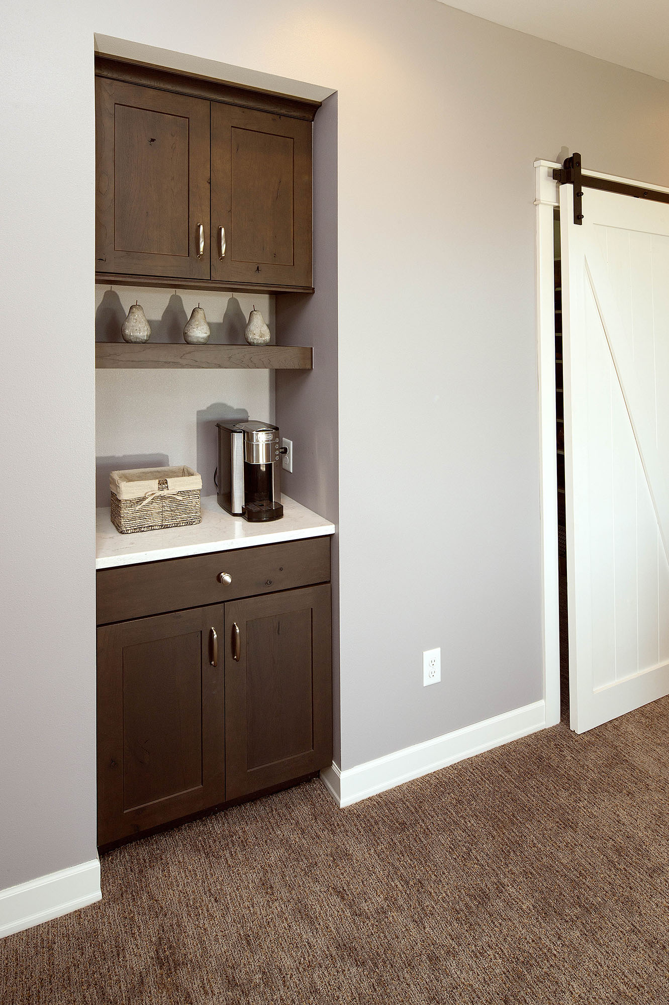 Stained family room coffee bar in Peppercorn by Showplace Cabinetry