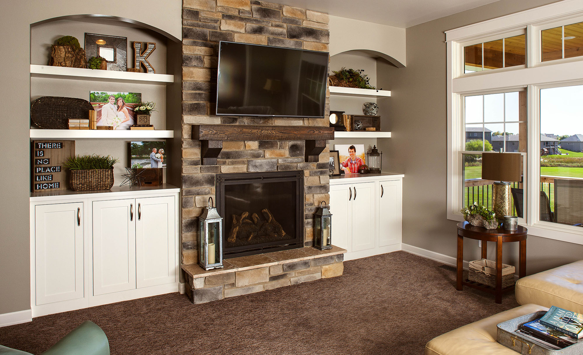 Painted family room cabinets in White by Showplace Cabinetry