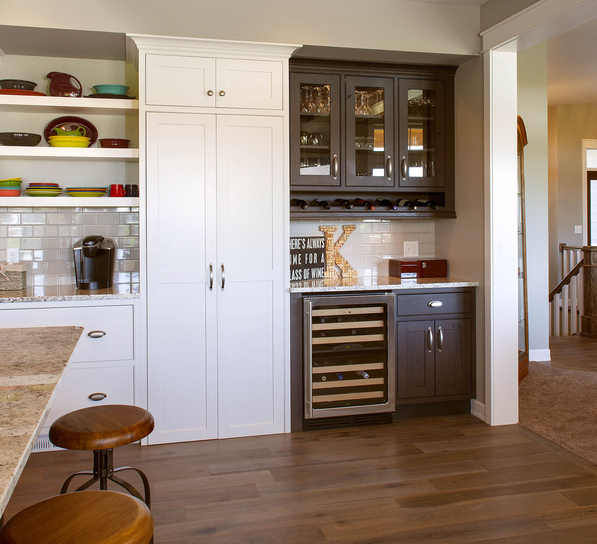 Stained kitchen bar in Peppercorn by Showplace Cabinetry