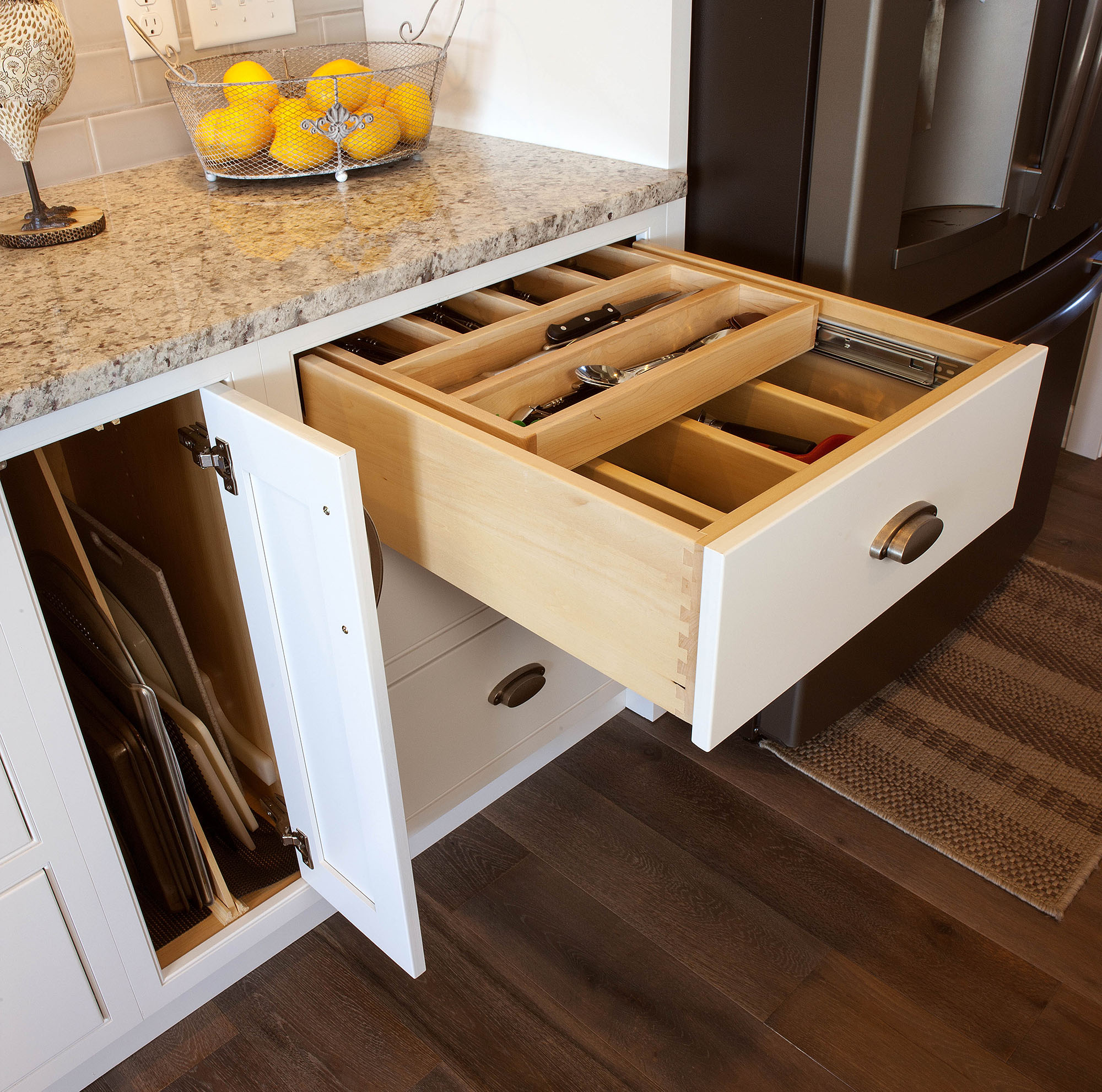 Painted kitchen cabinet with cutlery drawer in White by Showplace Cabinetry