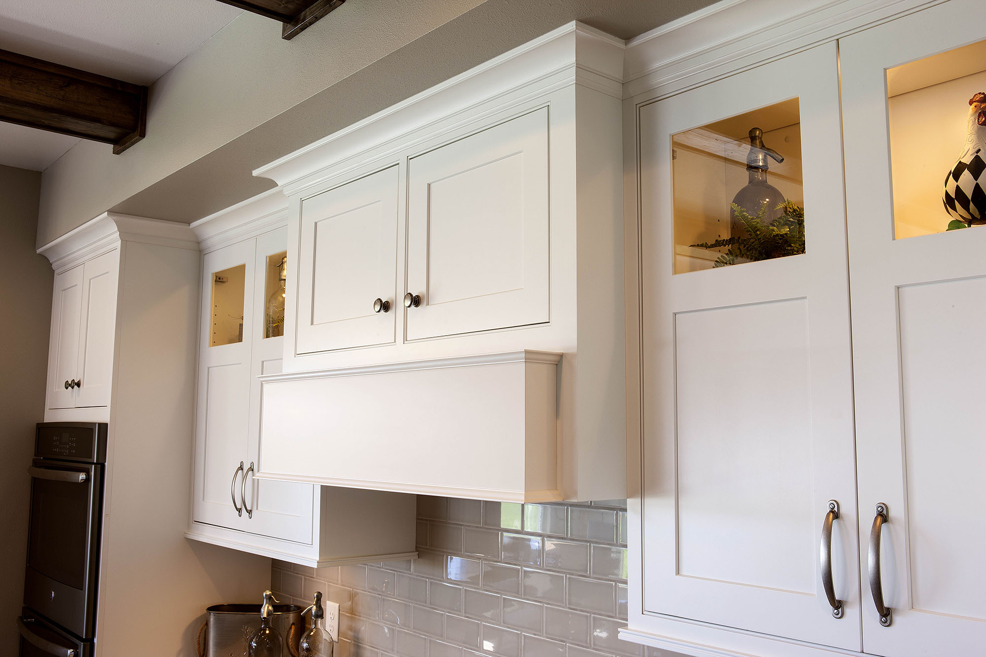 Painted kitchen ranged hood in White by Showplace Cabinetry