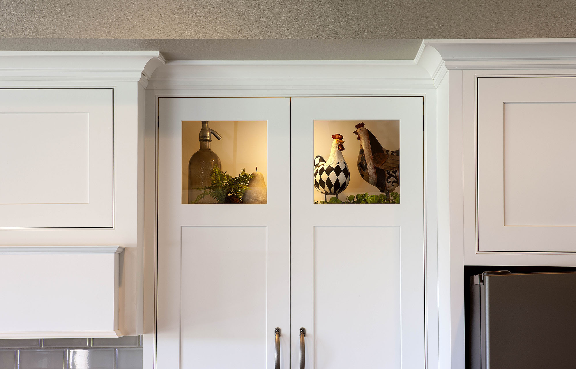 Painted kitchen lighted cabinet in White by Showplace Cabinetry