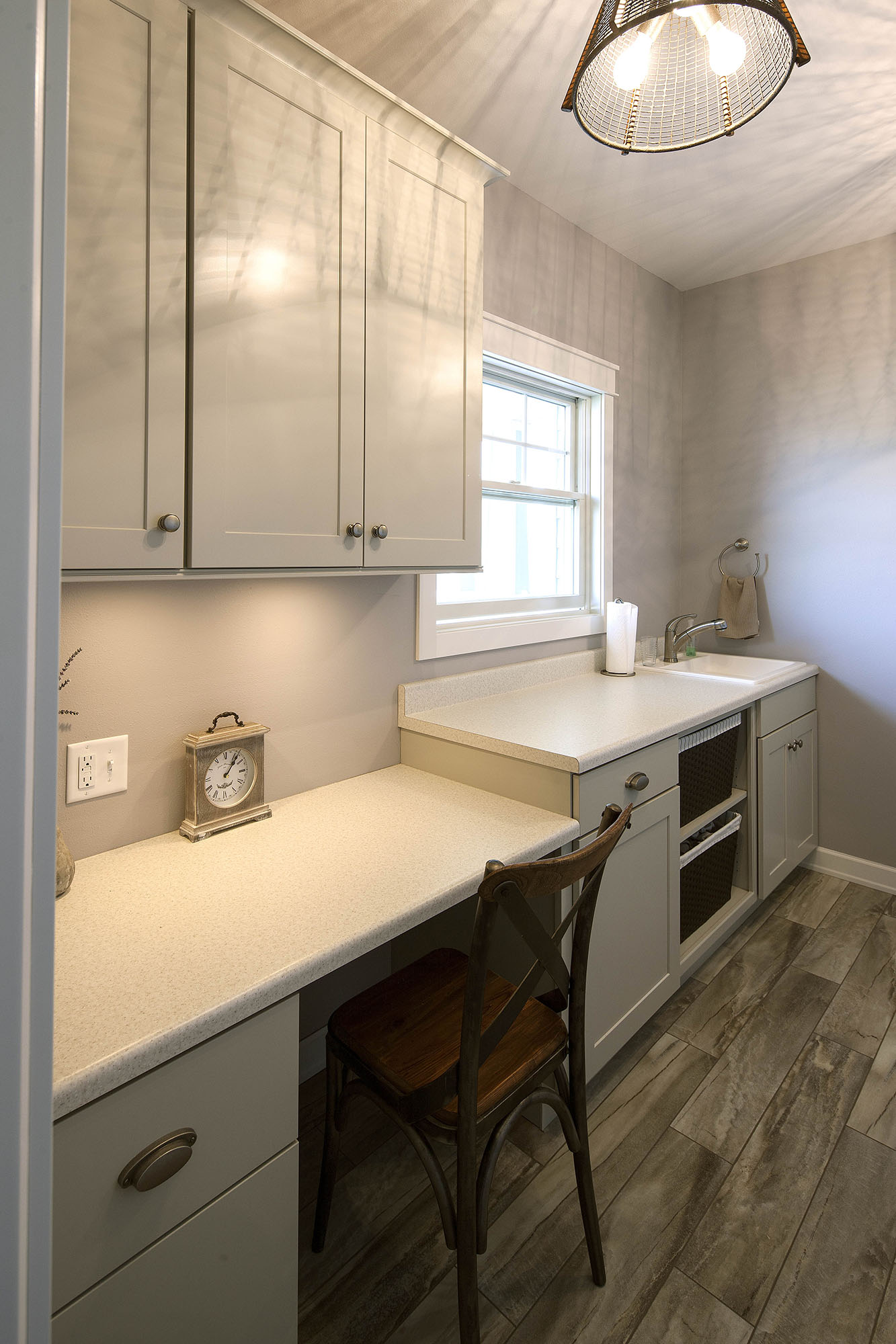 Painted laundry room cabinets in Oyster by Showplace Cabinetry - view 1