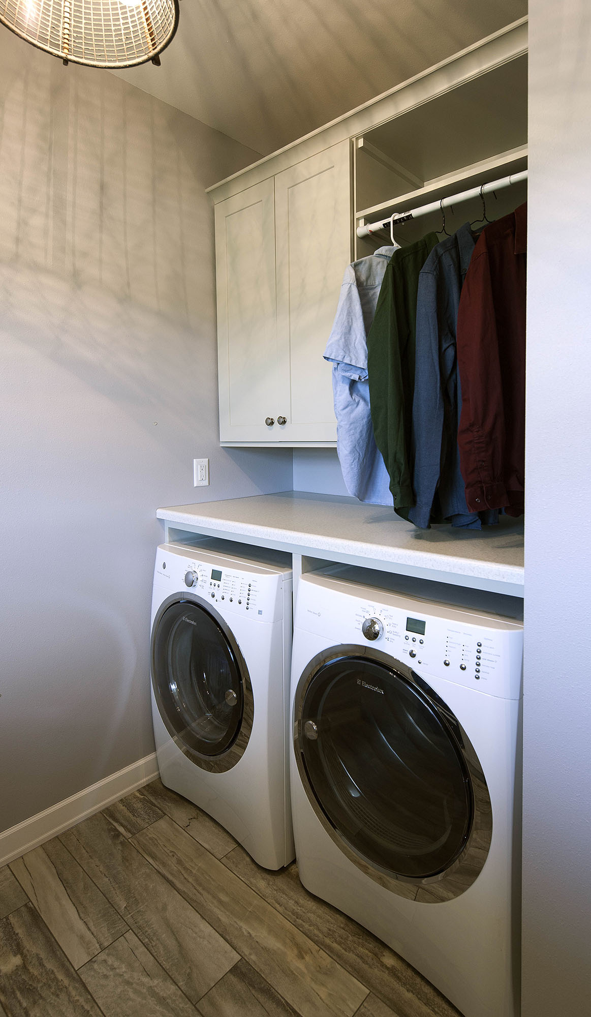 Painted laundry room cabinets in Oyster by Showplace Cabinetry - view 2