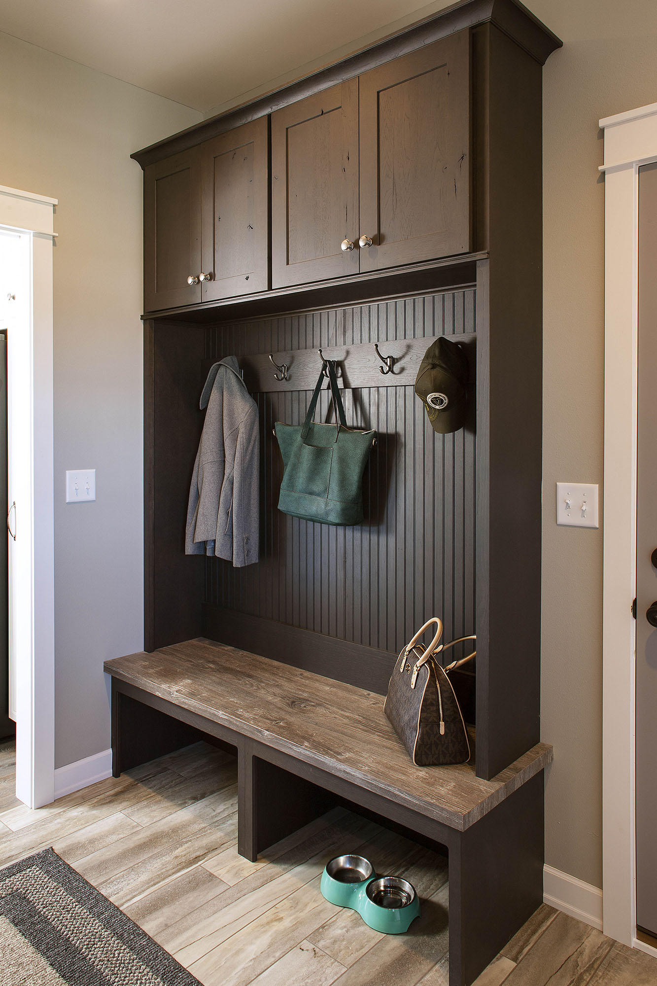Stained mud room locker in Peppercorn by Showplace Cabinetry