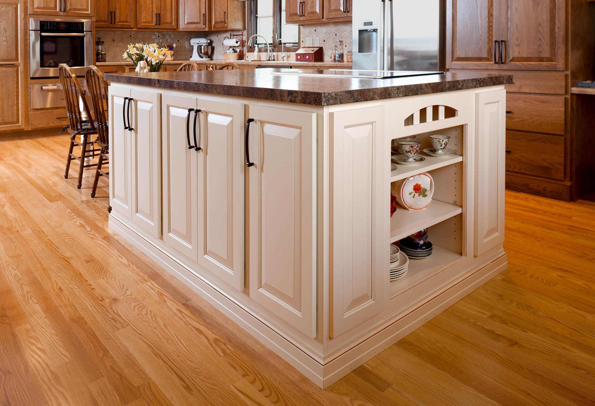 Stained kitchen island in Linen with Carmel Glaze by Showplace Cabinetry - view 1