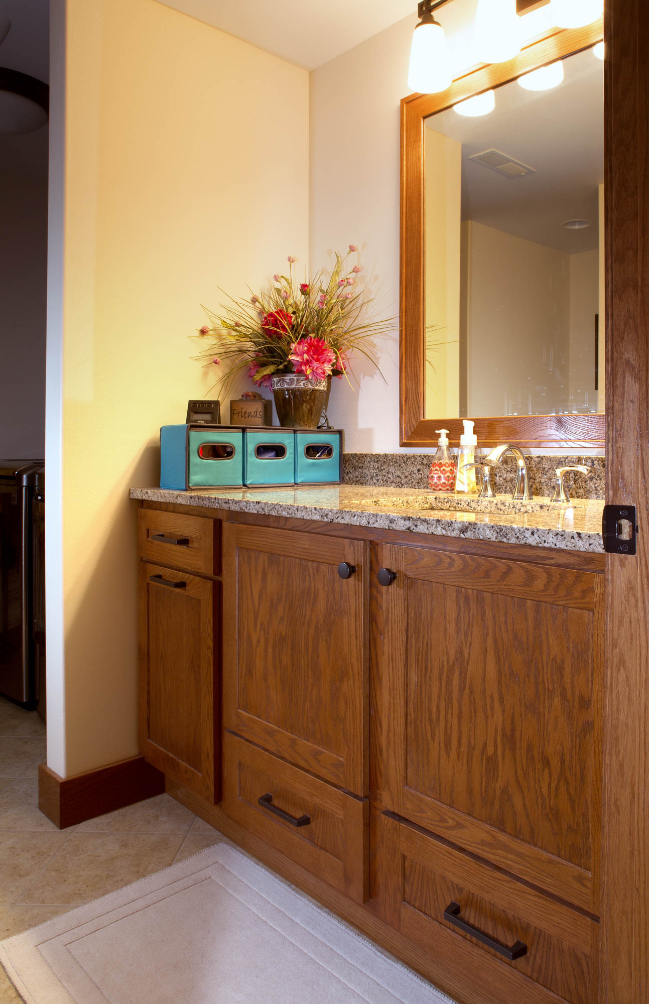 Stained powder room vanity in Autumn by Showplace Cabinetry