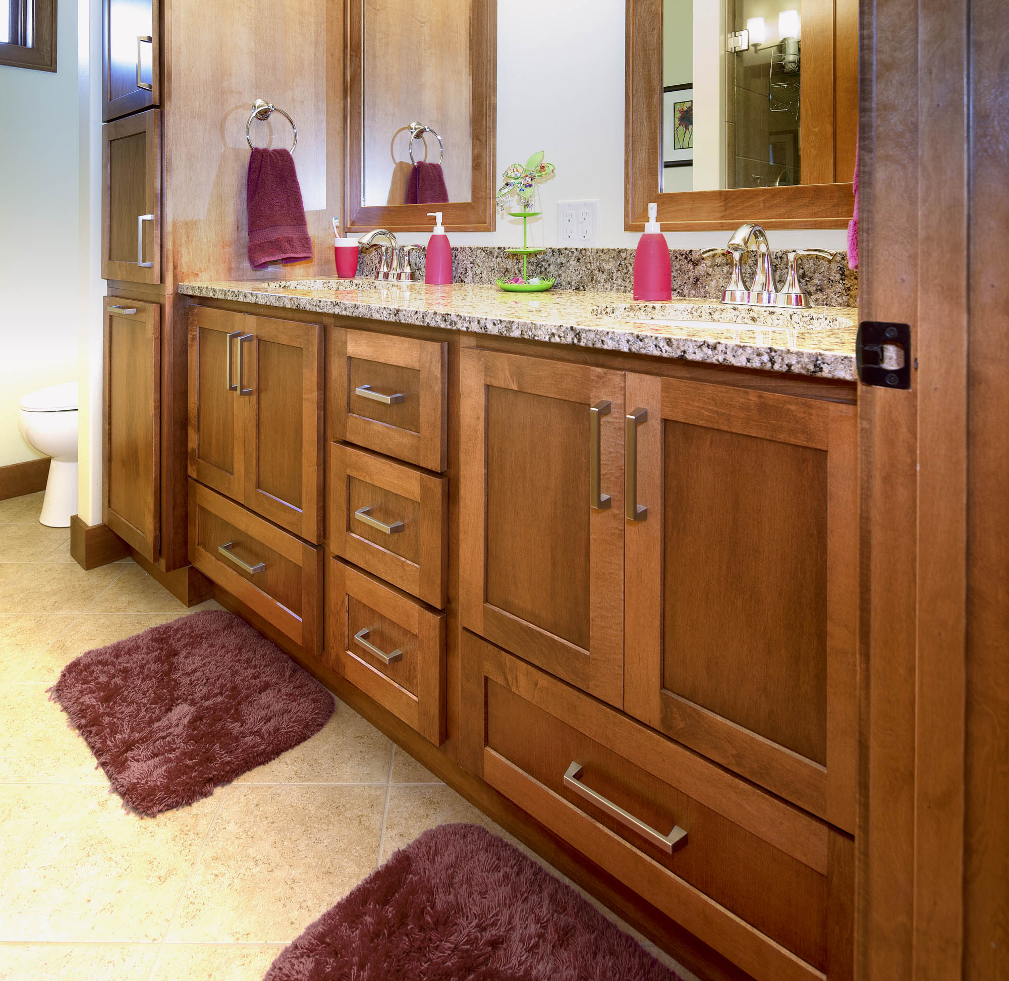 Stained guest bathroom vanity in Autumn by Showplace Cabinetry