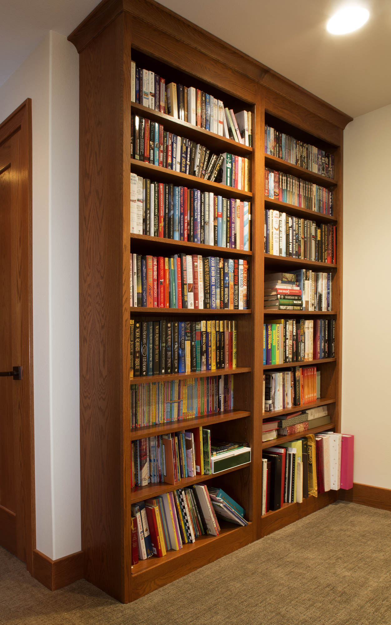 Stained family room bookcase in Autumn by Showplace Cabinetry
