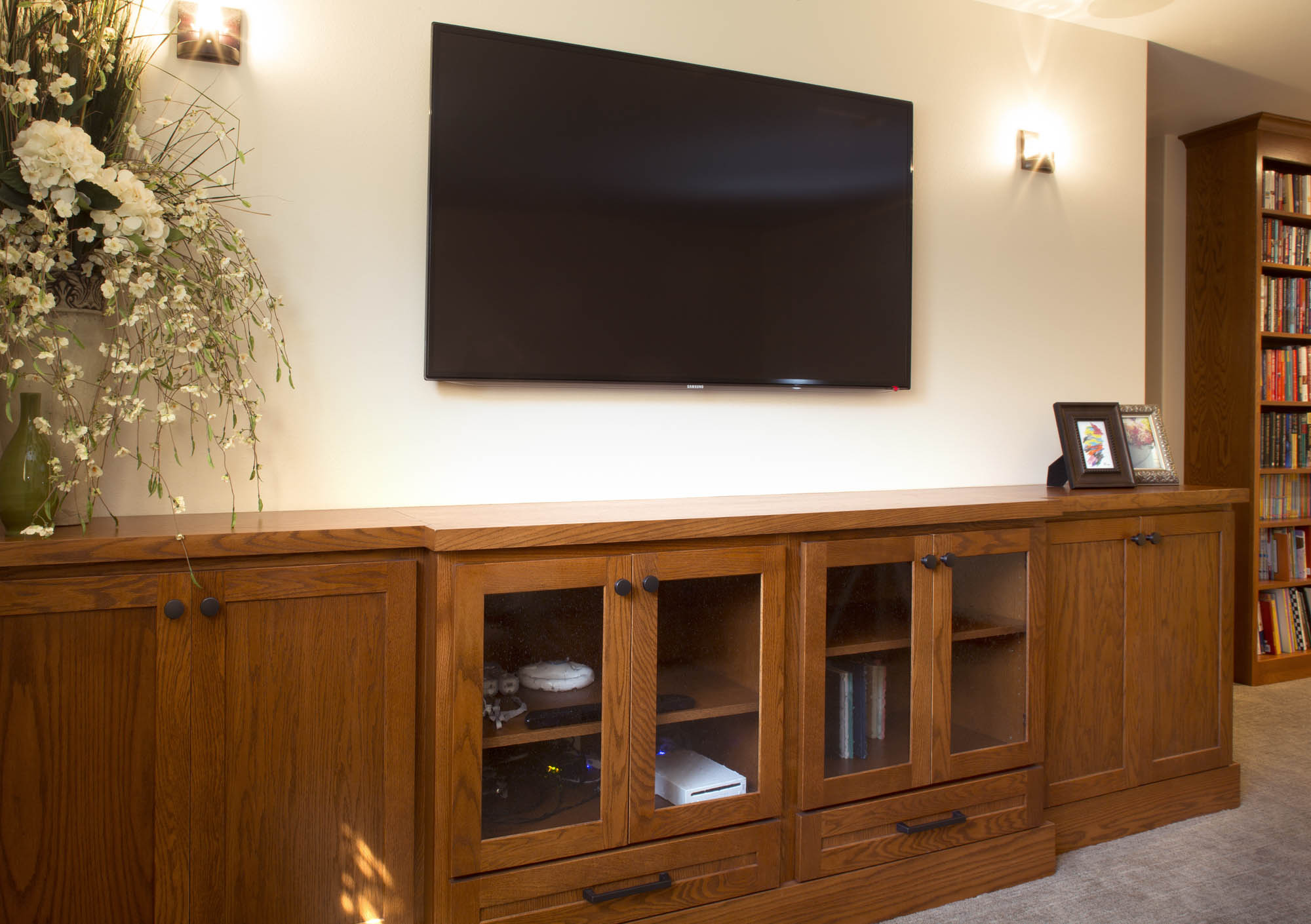Stained family room entertainment center in Autumn by Showplace Cabinetry