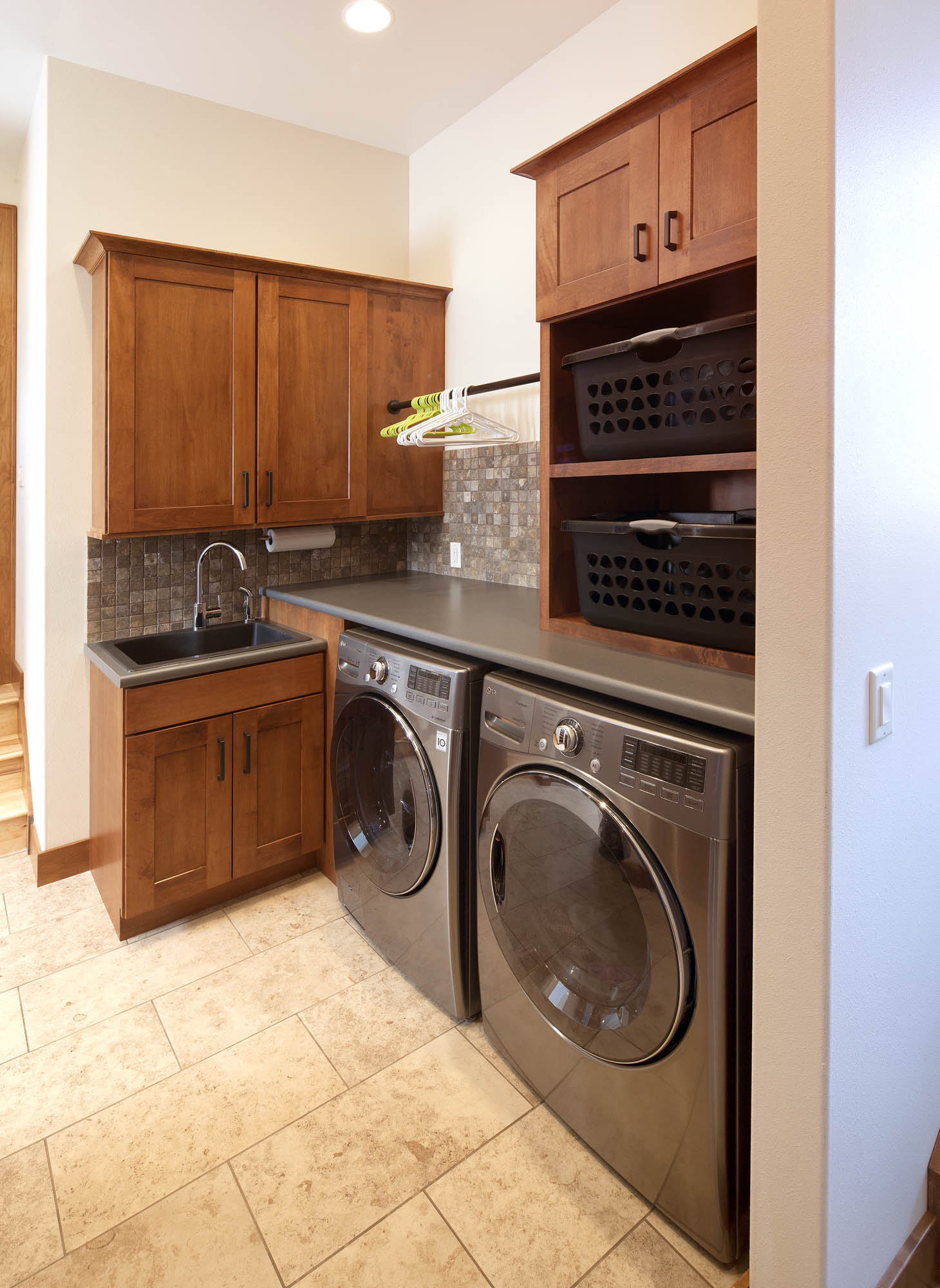 Stained laundry room cabinets in Autumn by Showplace Cabinetry