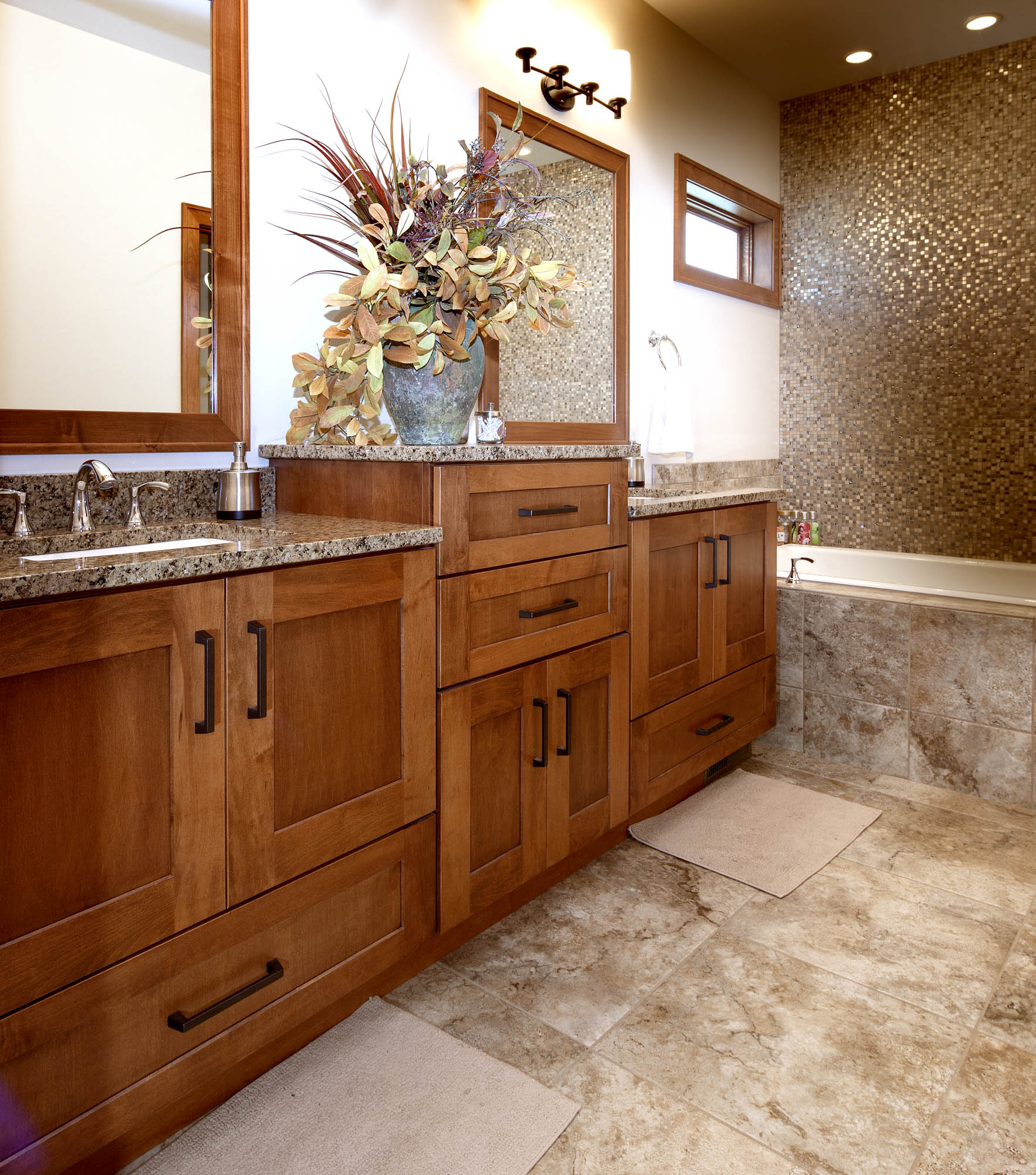 Stained master bathroom vanity in Autumn by Showplace Cabinetry