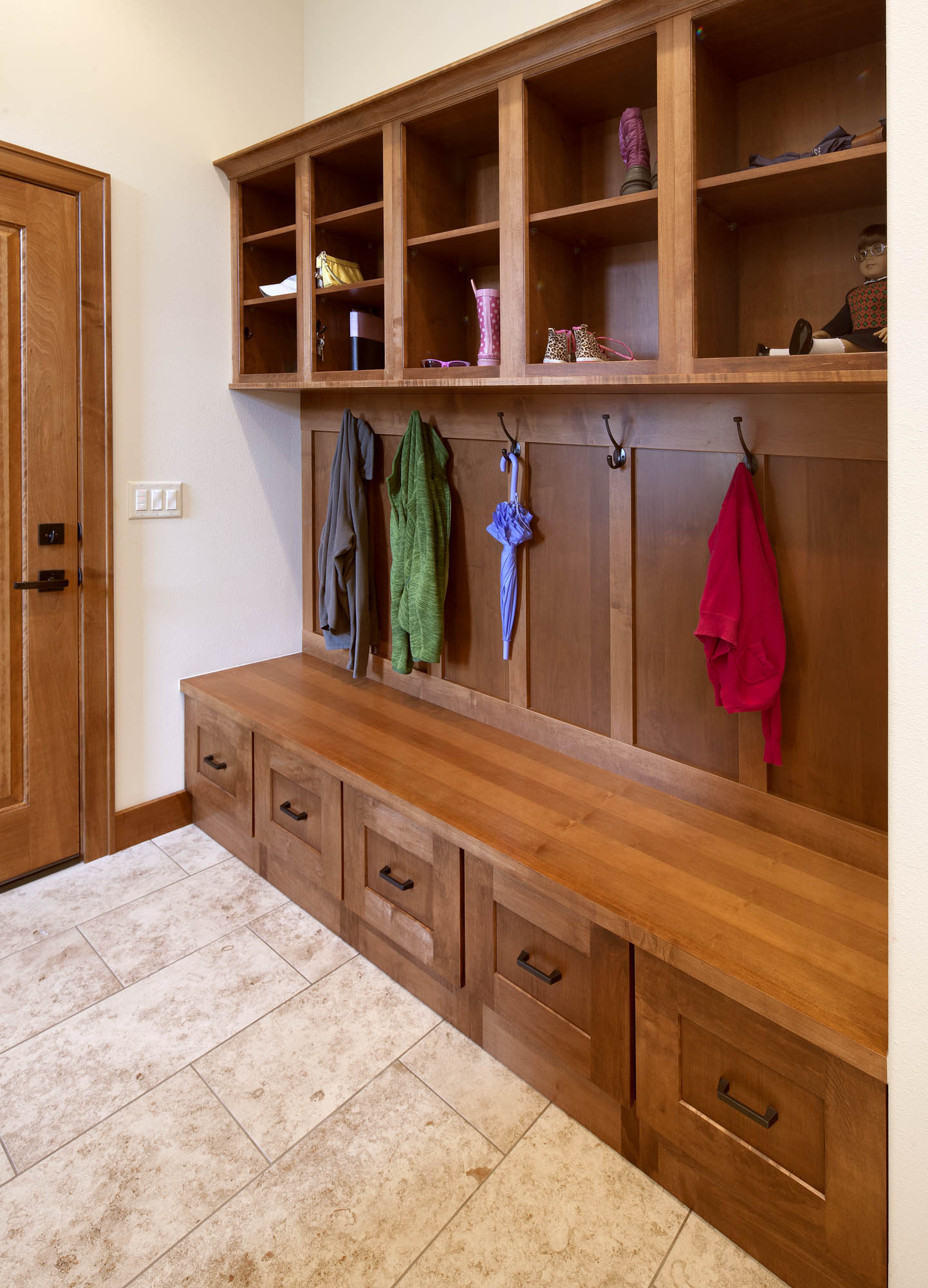 Stained mudroom locker in Autumn by Showplace Cabinetry