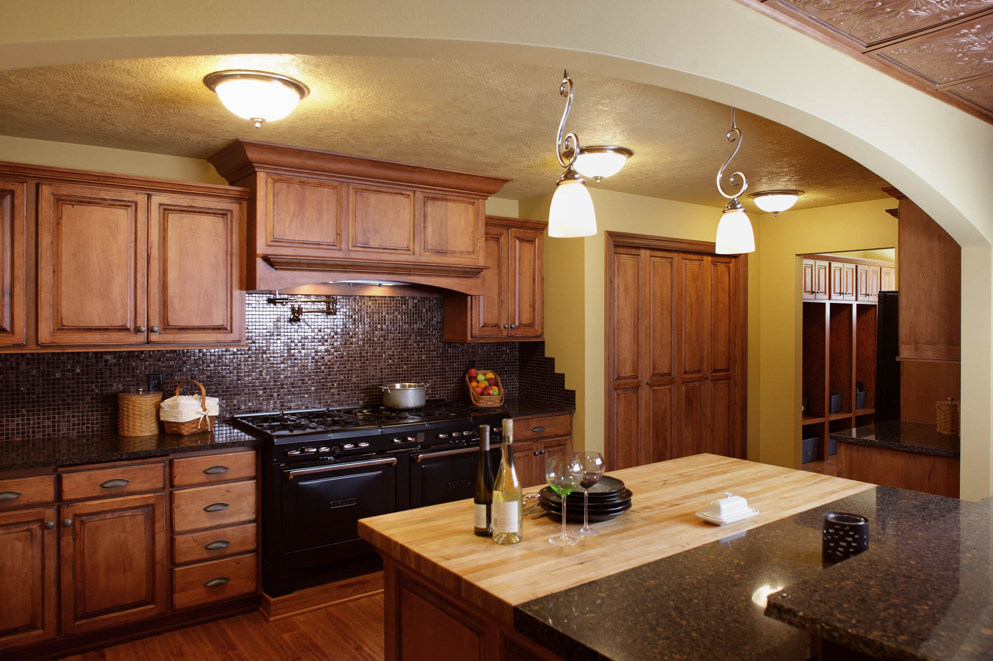 Renew | Stained kitchen cabinets in Vintage Autumn by Showplace Cabinetry - view 2