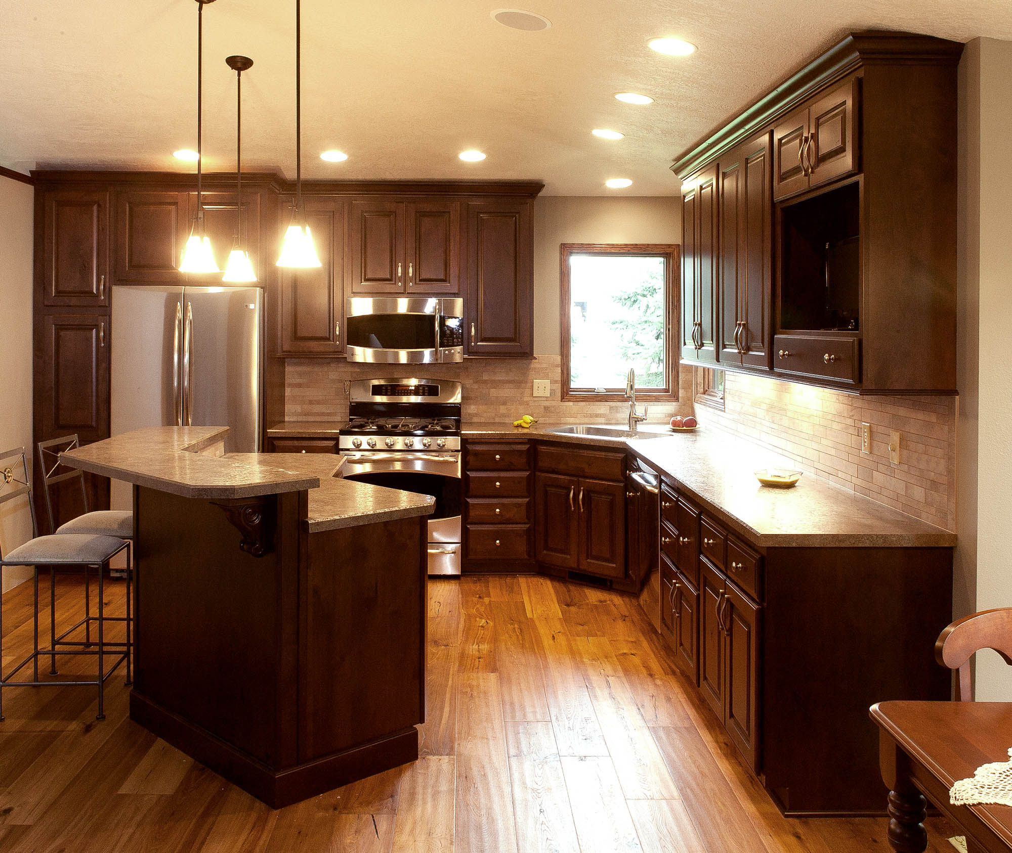 Renew | Stained kitchen cabinets in Coffee with Ebony Glaze by Showplace Cabinetry - view 2