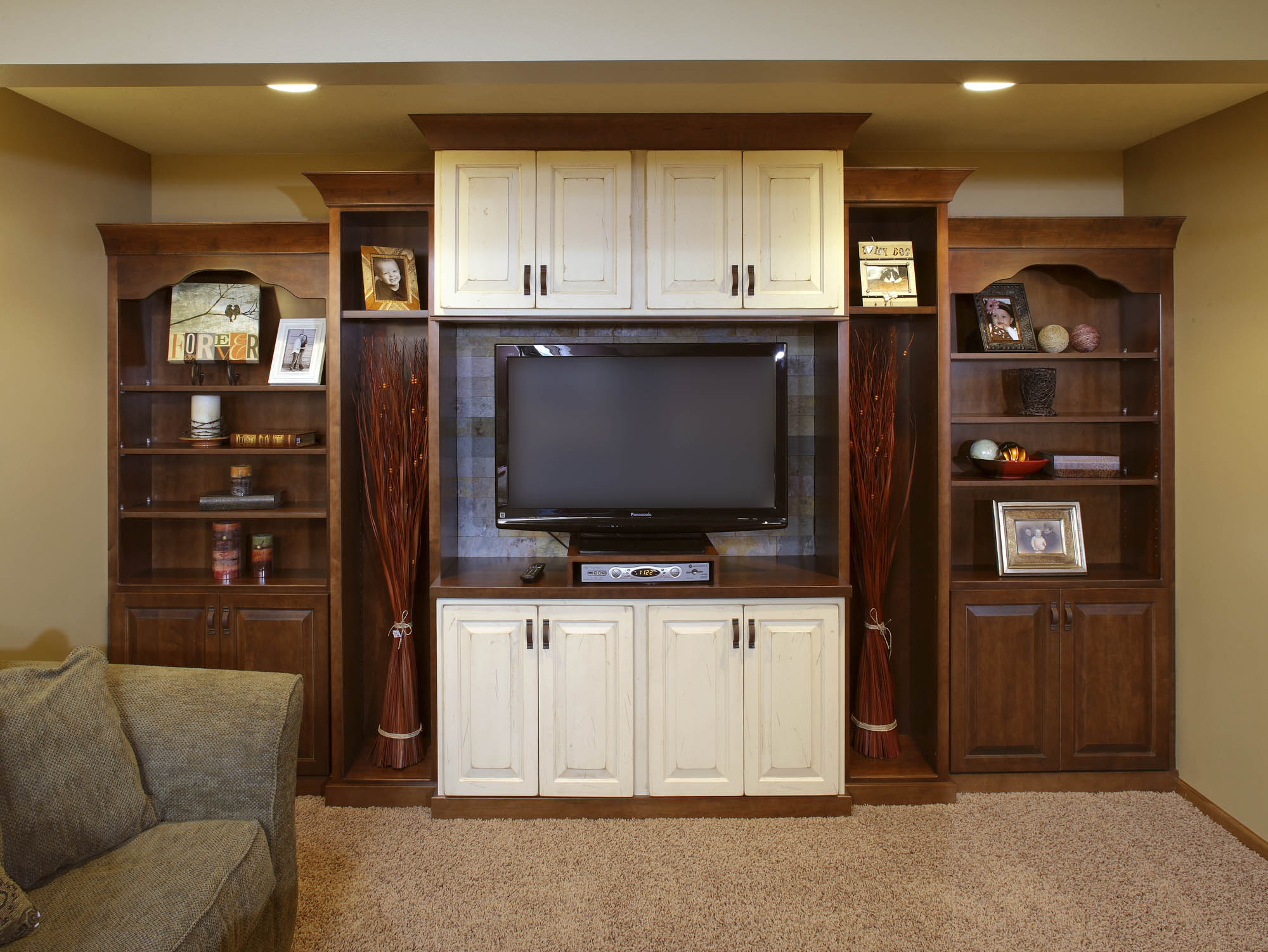 Stained and Painted family room entertainment center in Harvest and Vintage Linen by Showplace Cabinetry