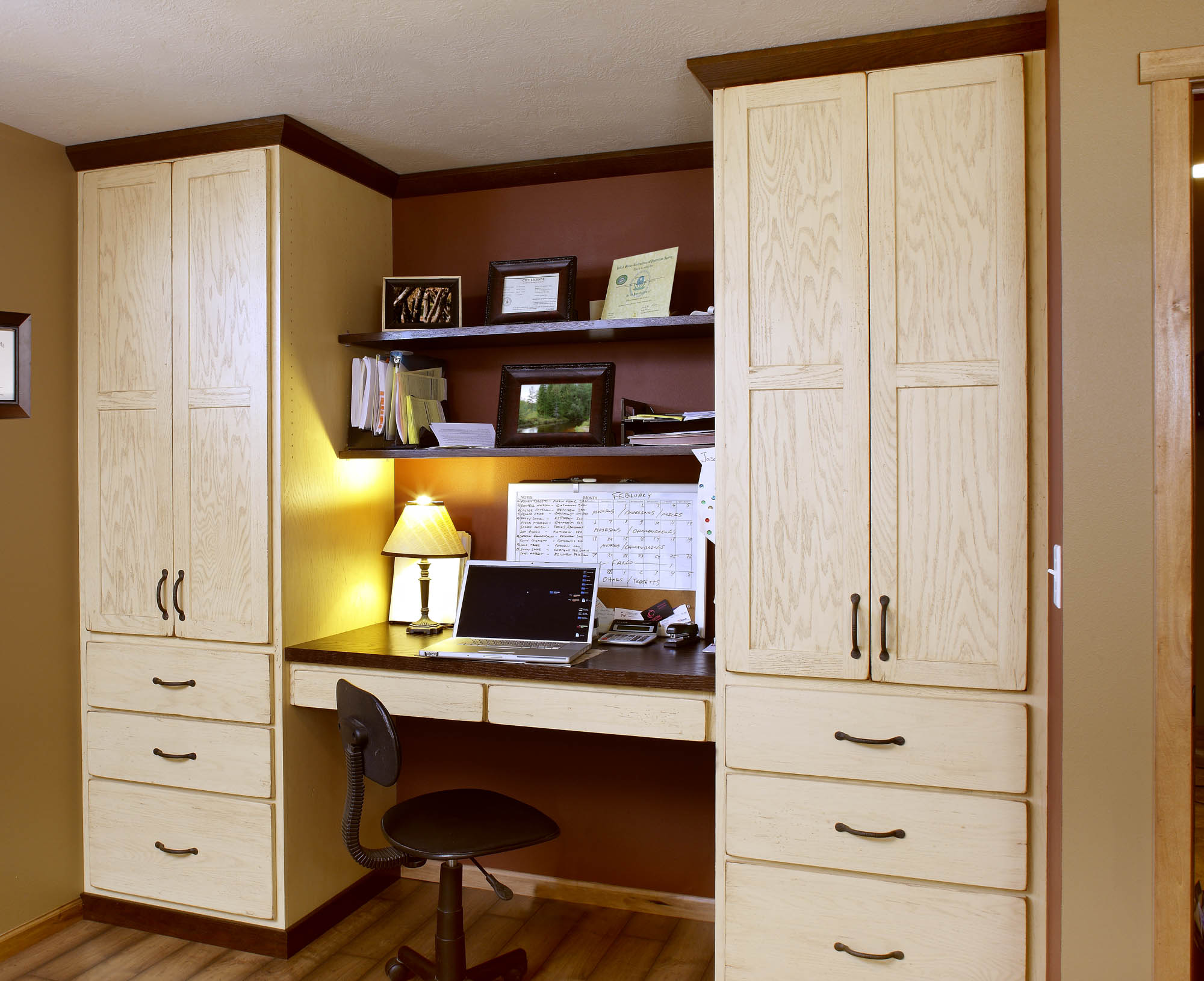 Stained home office cabinets in Vintage Soft Yellow by Showplace Cabinetry