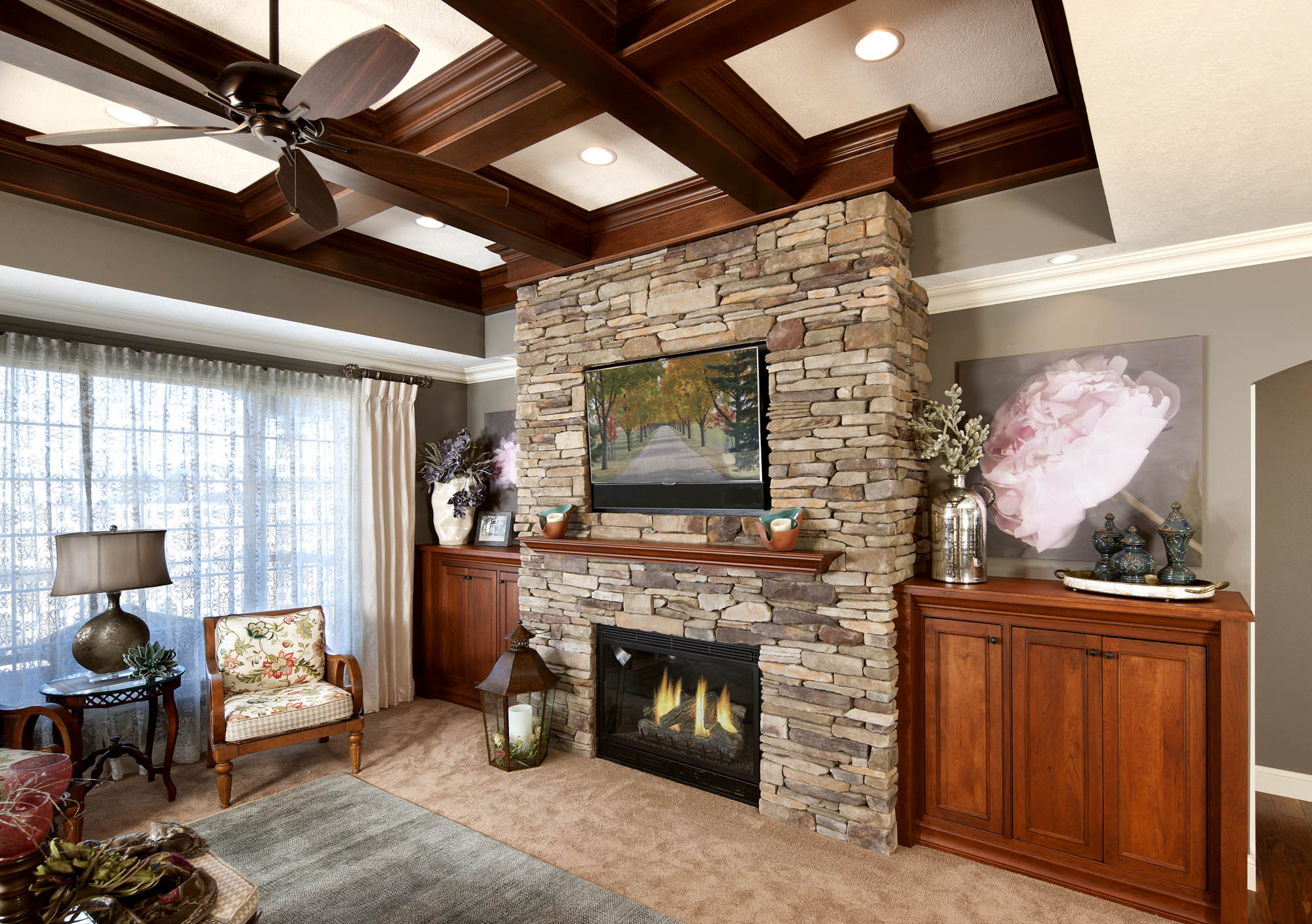 Stained family room fireplace in Vintage Autumn by Showplace Cabinetry