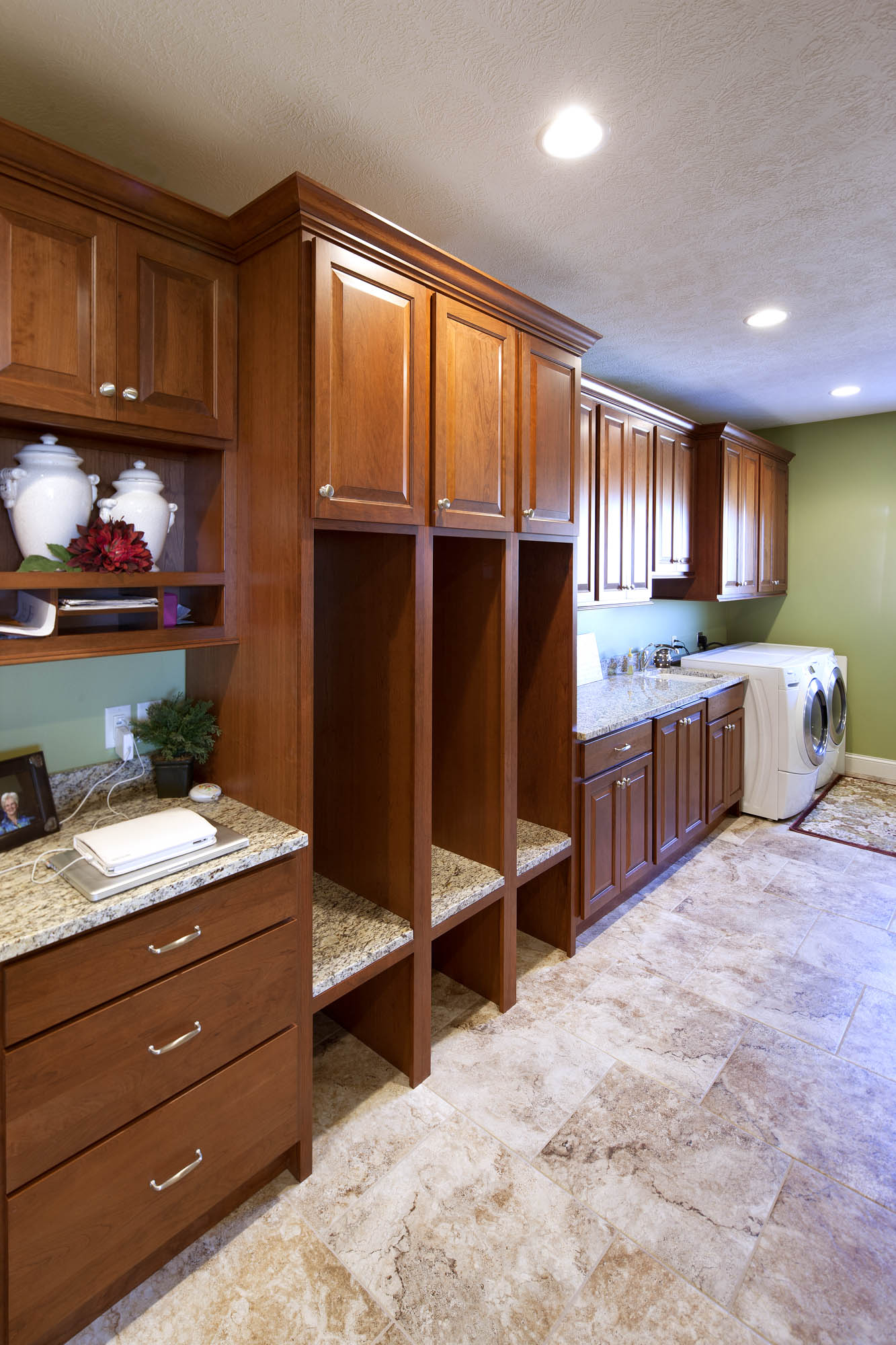 Stained mudroom cabinets in Autumn with Ebony Glaze by Showplace Cabinetry