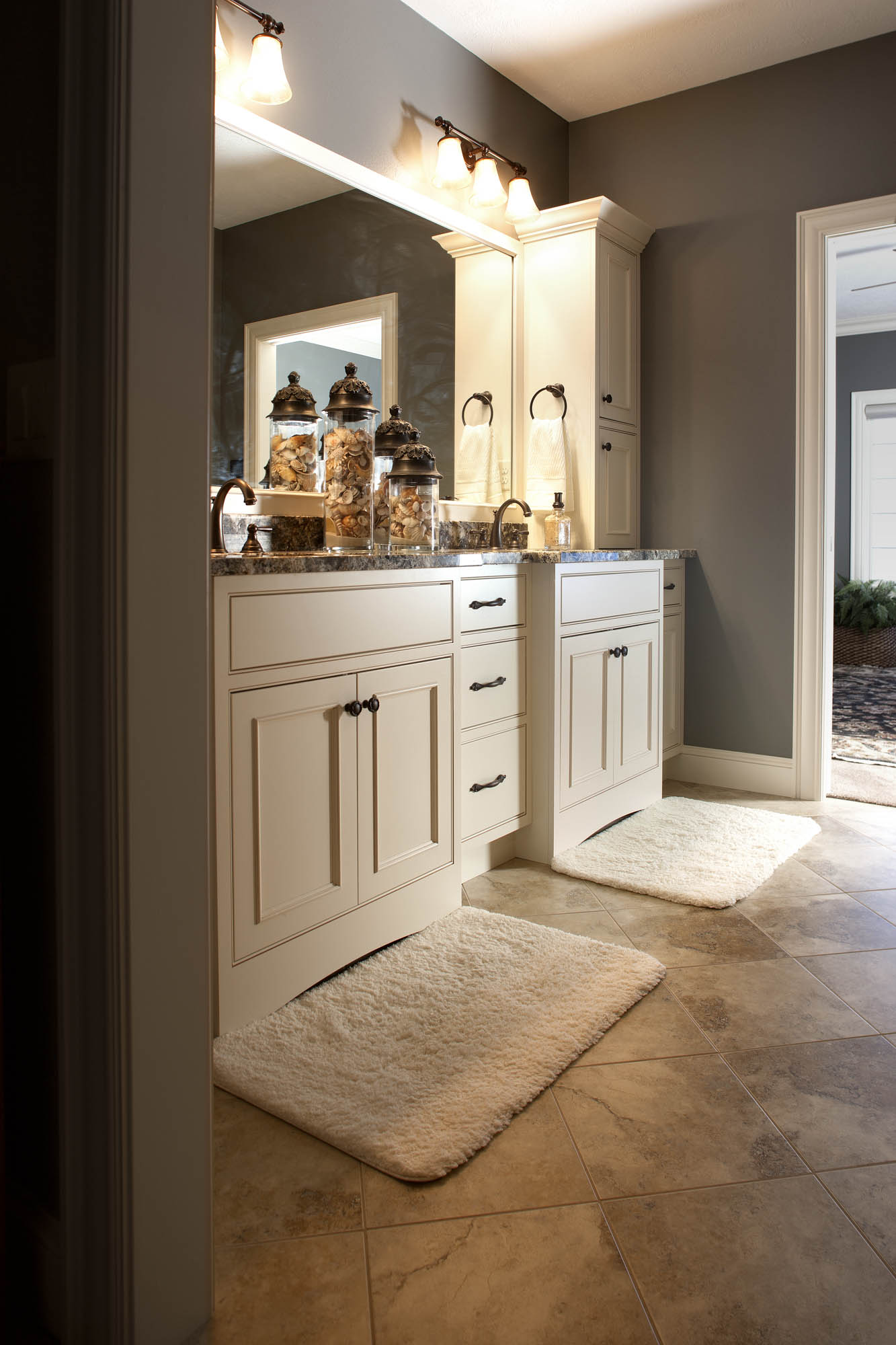 Painted master bathroom vanity in Soft Cream with Oatmeal Glaze by Showplace Cabinetry - view 1