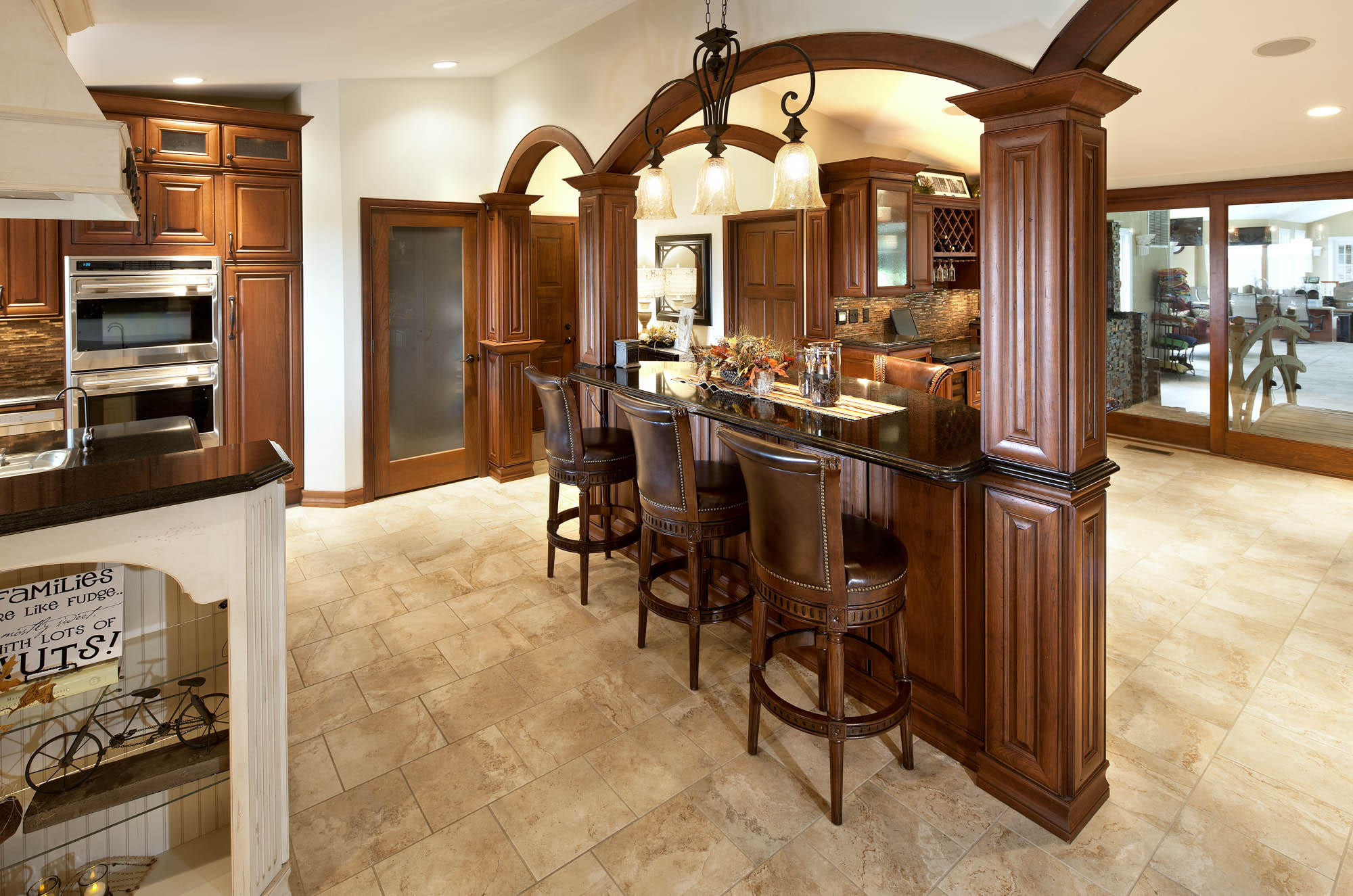 Stained kitchen room divider cabinets in Vintage Autumn by Showplace Cabinetry - view 1