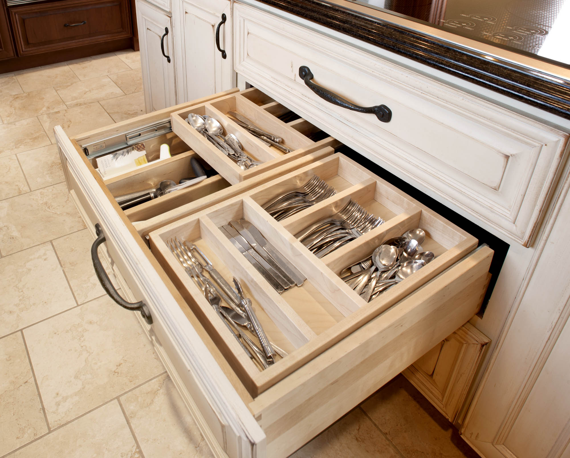 Painted kitchen island with cutlery drawer in Vintage Soft Cream by Showplace Cabinetry