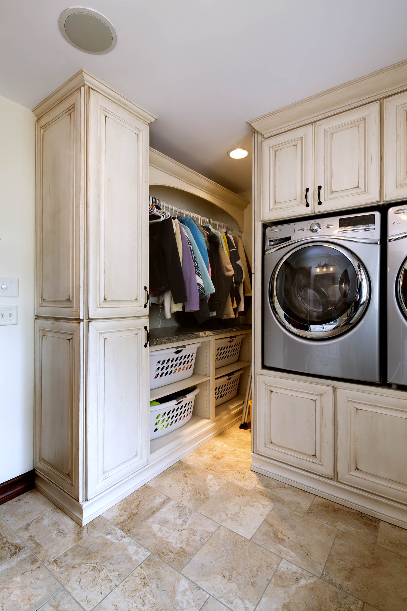 Painted laundry room cabinets in Vintage Soft Cream by Showplace Cabinetry - view 1