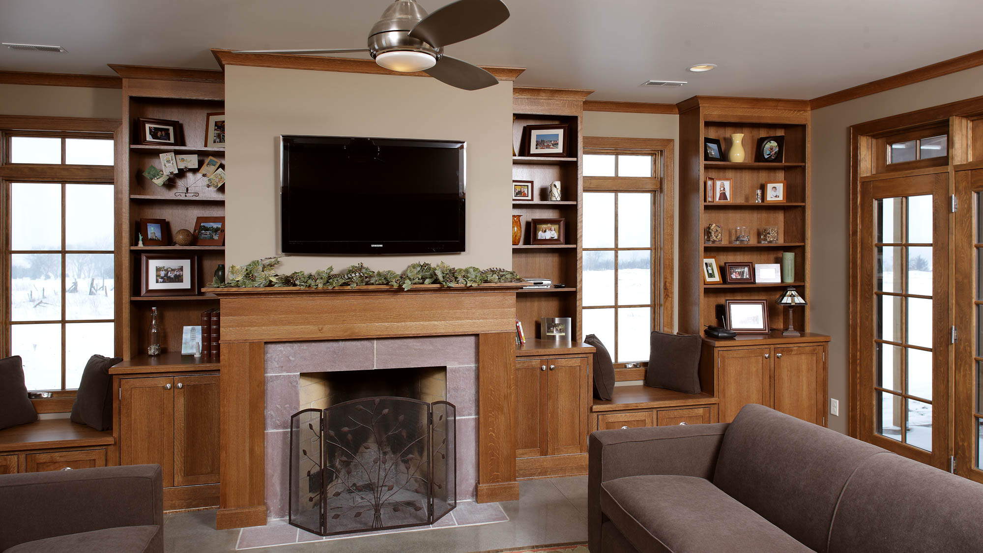 Stained family room fireplace surround in Truffle by Showplace Cabinetry