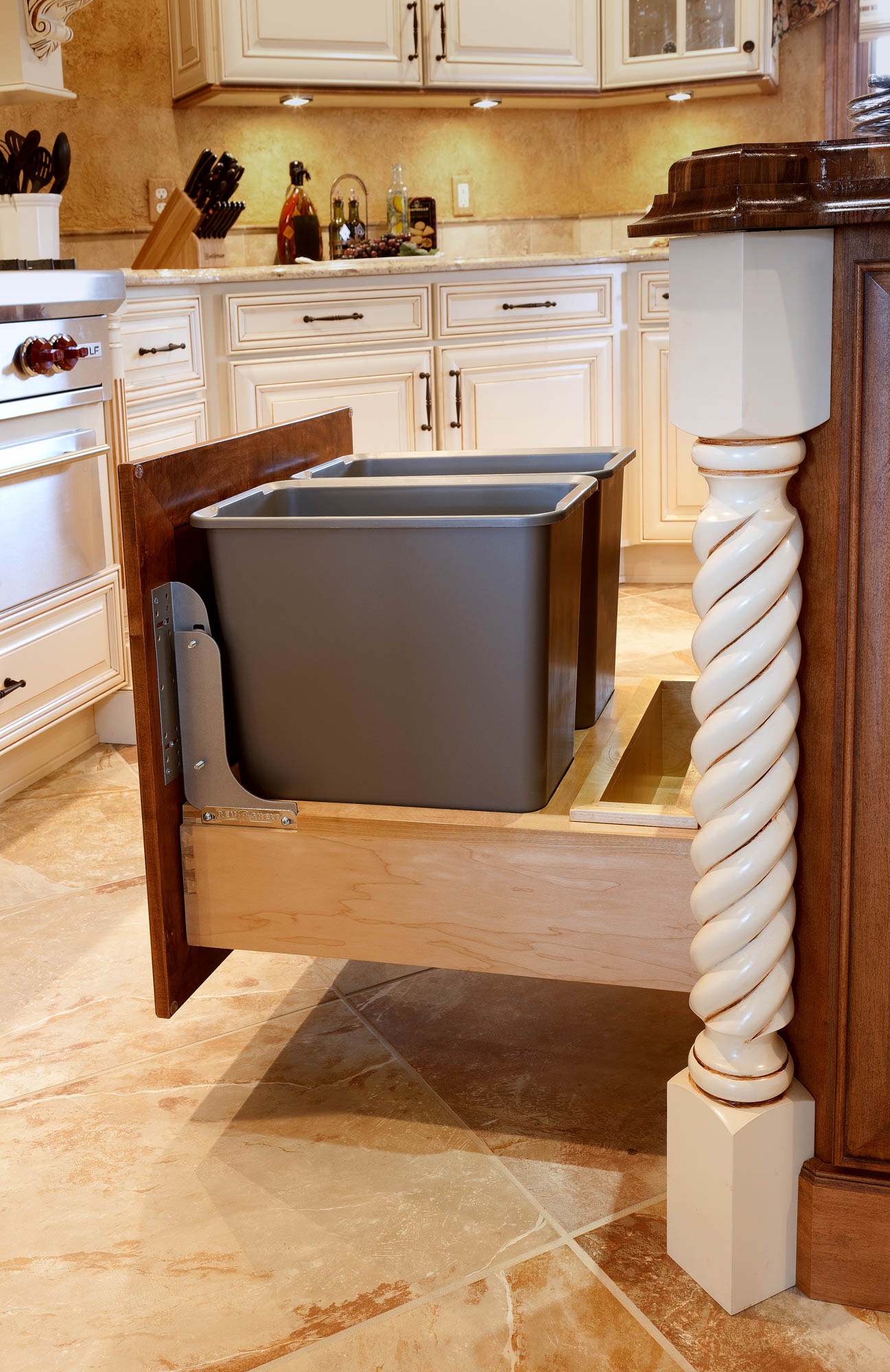 Stained island with recycle in Autumn with Ebony Glaze by Showplace Cabinetry