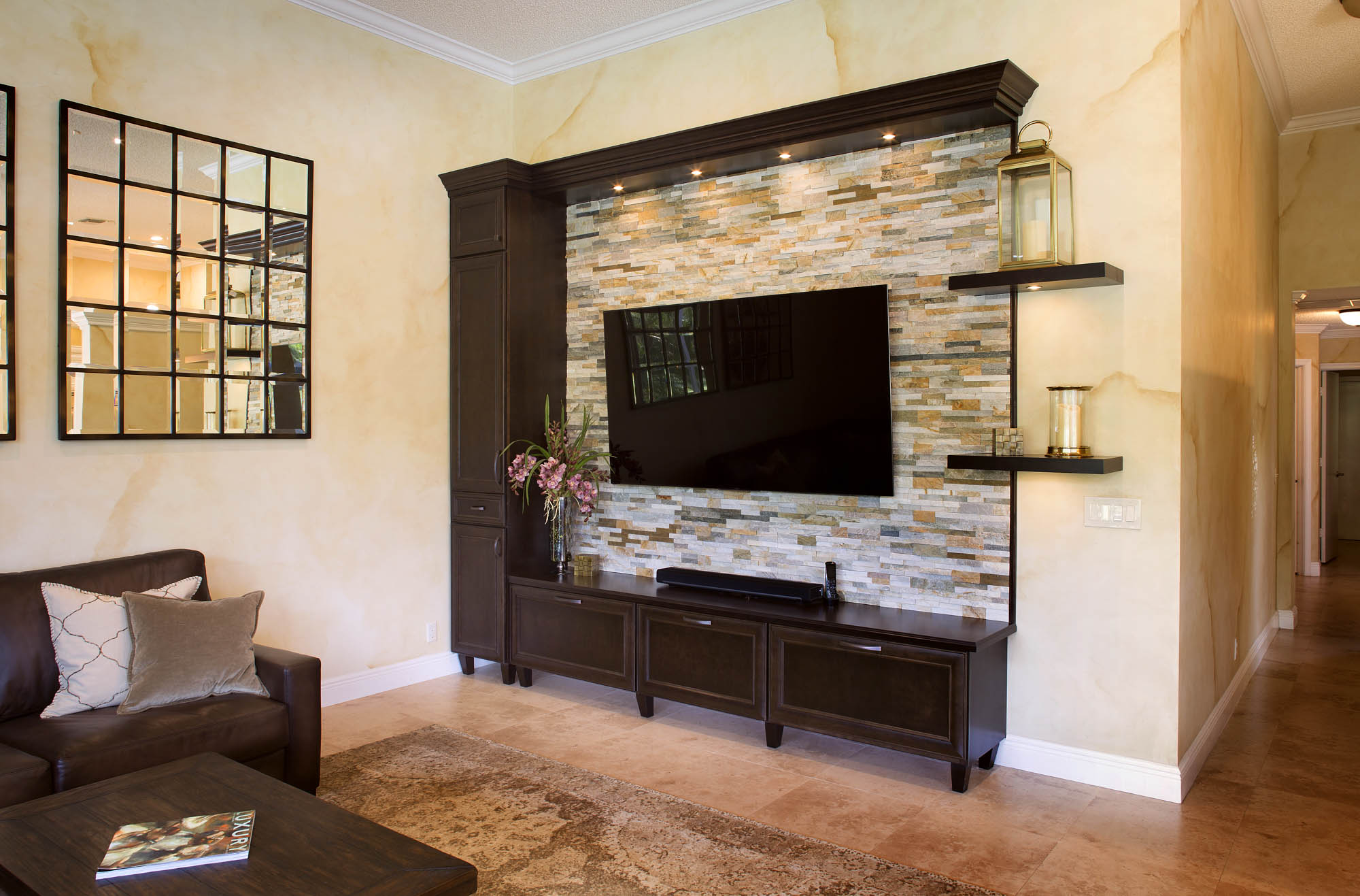 Stained family room entertainment center in Espresso by Showplace Cabinetry