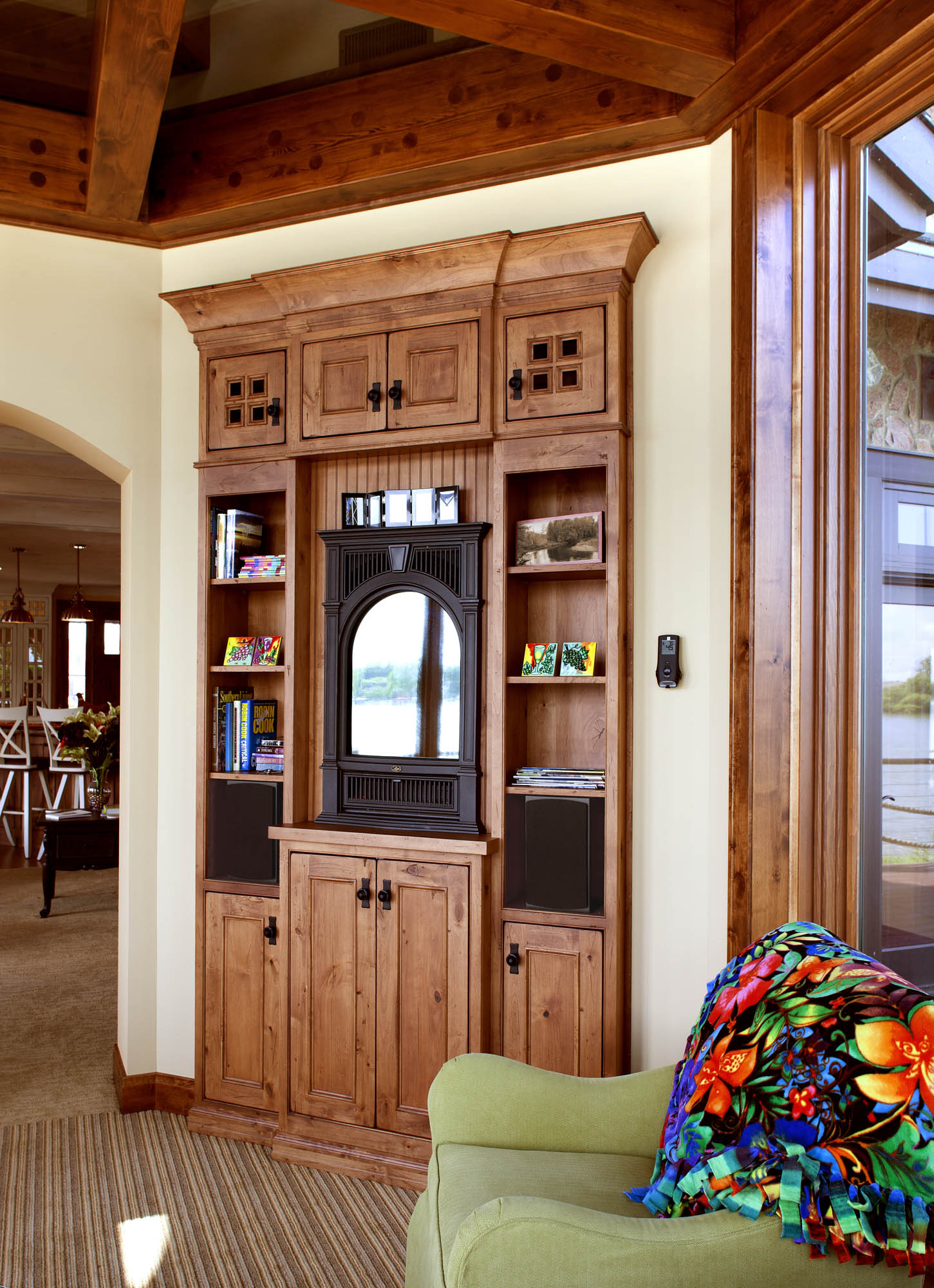 Stained reading room entertainment center in Vintage Nutmeg by Showplace Cabinetry