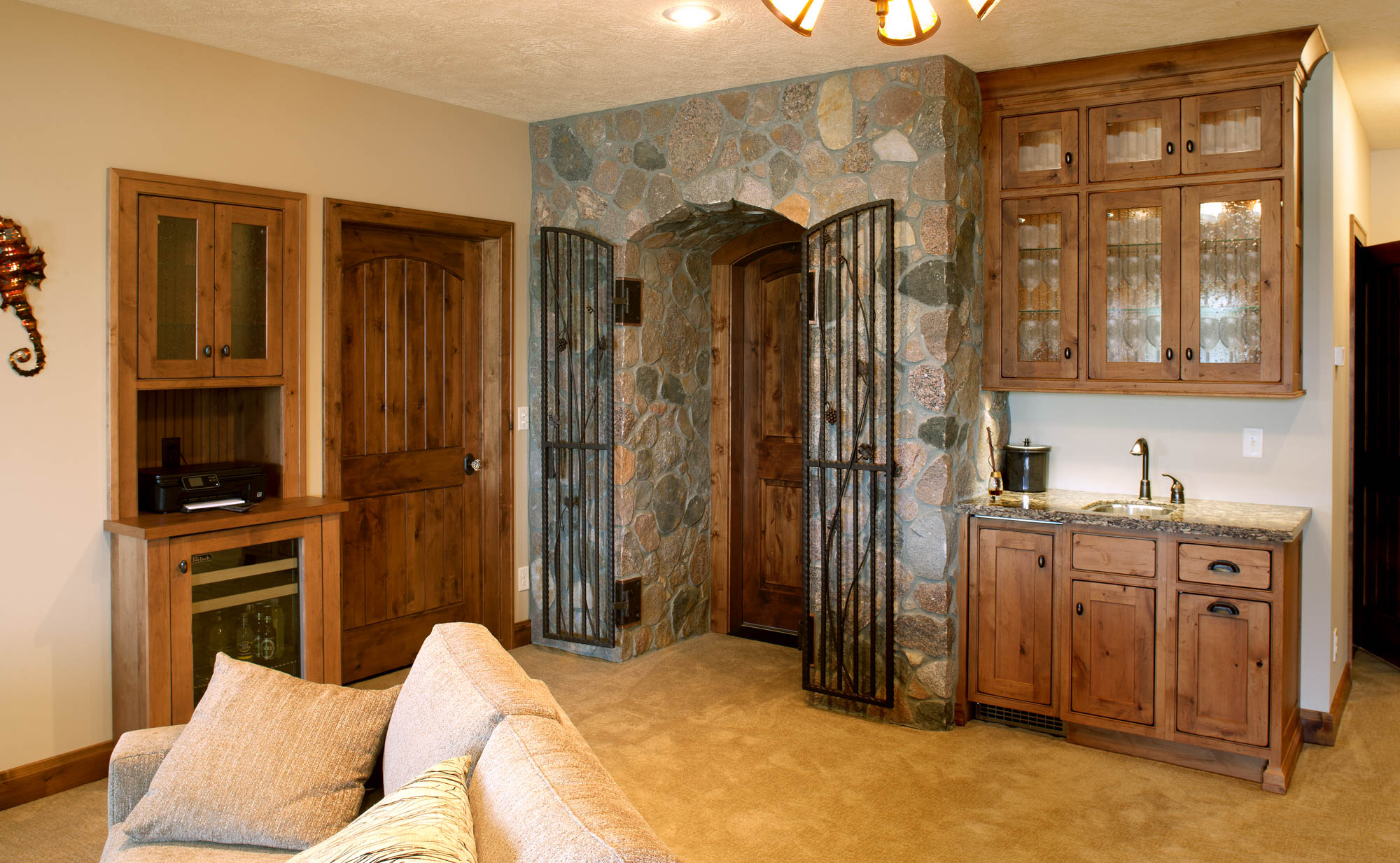 Stained wine cellar cabinets in Vintage Nutmeg by Showplace Cabinetry - view 1
