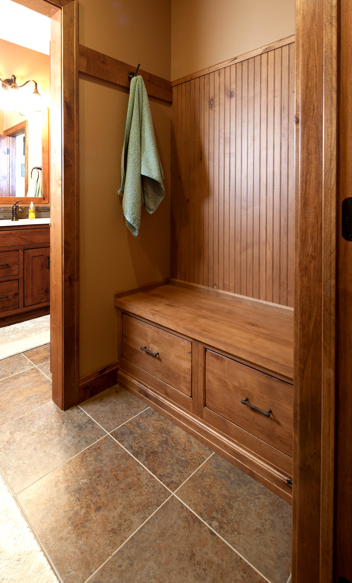 Stained guest bathroom locker in Vintage Nutmeg by Showplace Cabinetry
