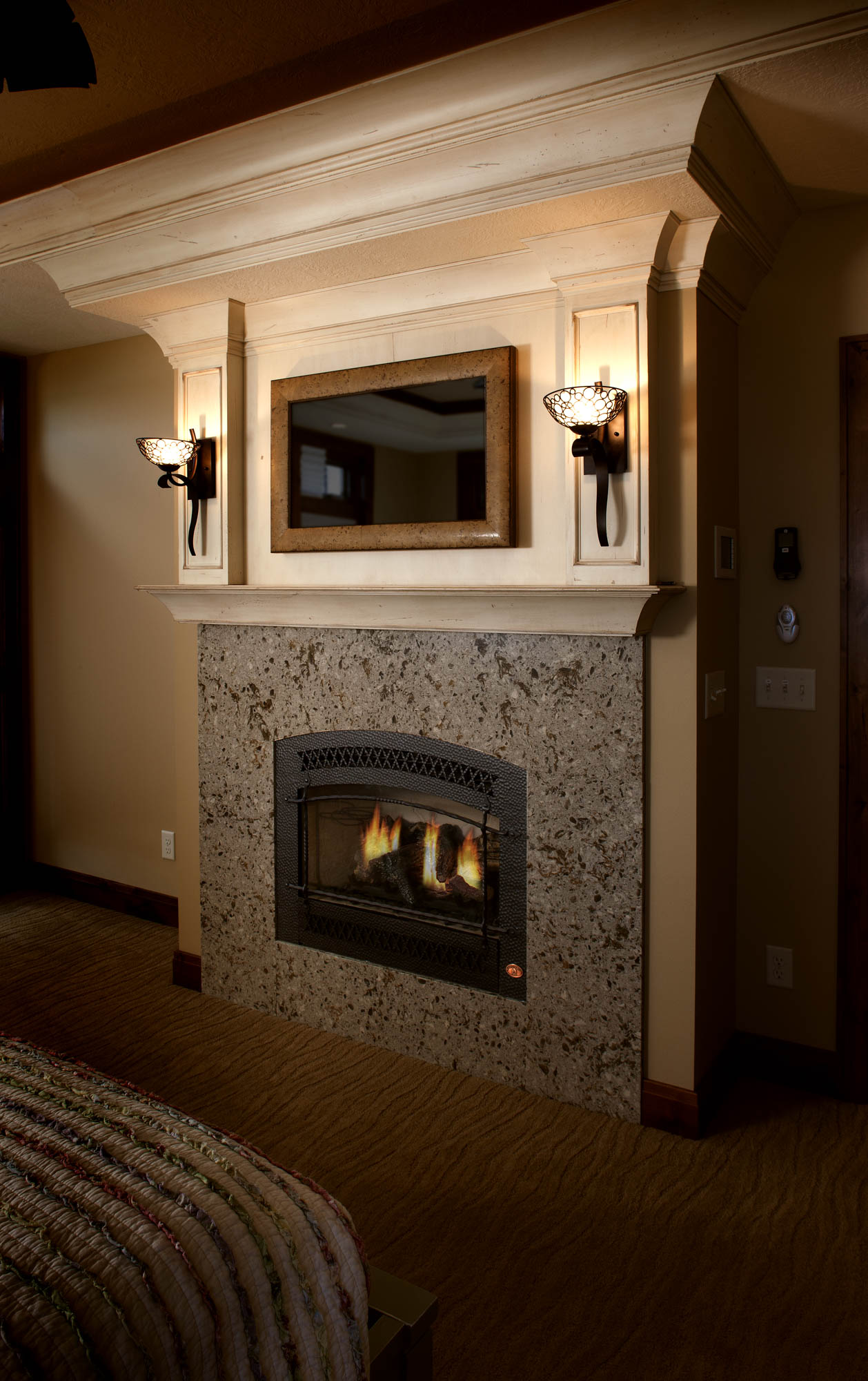Painted master bedroom fireplace surround in Vintage Soft Cream by Showplace Cabinetry