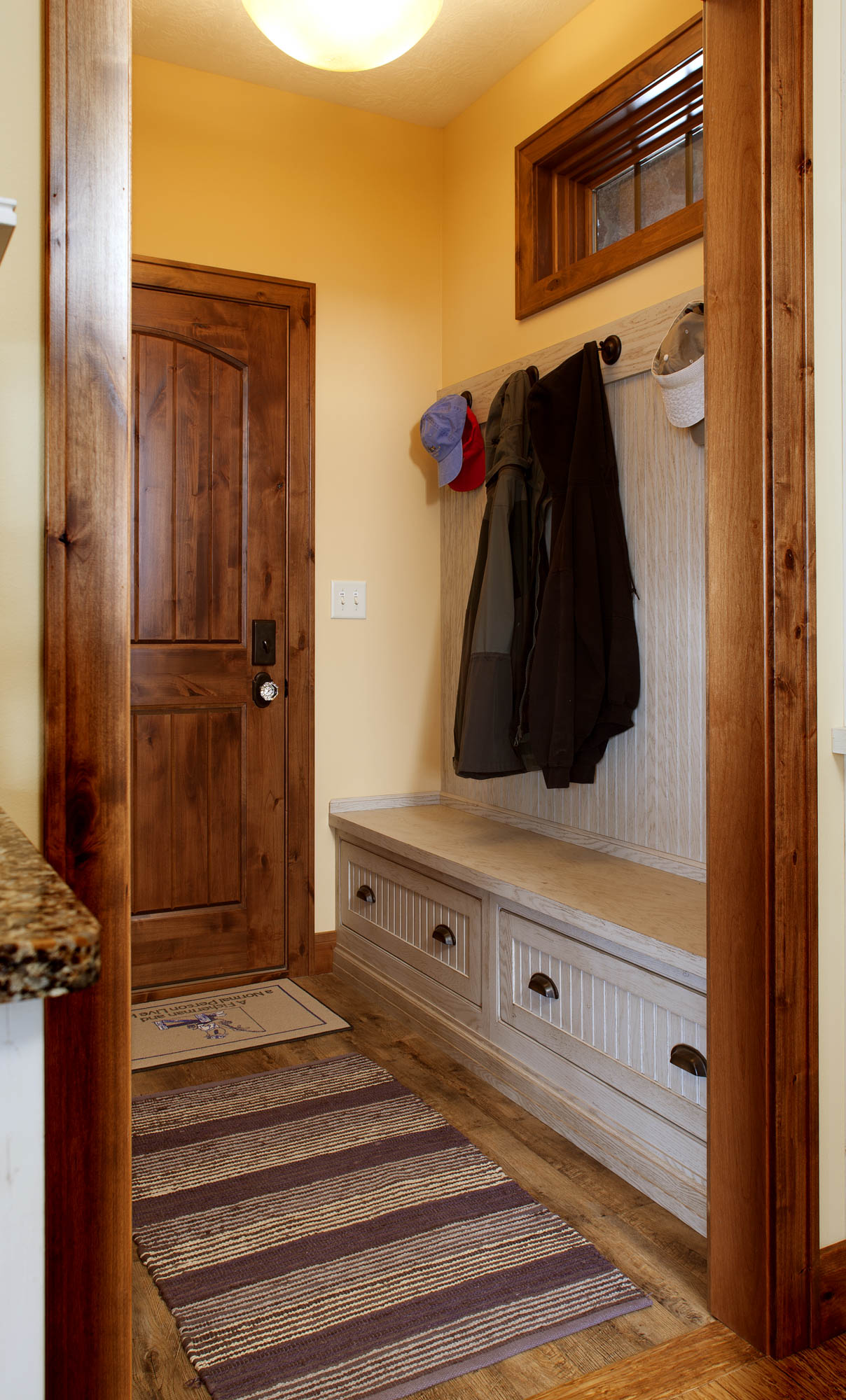 Painted mudroom locker in Vintage Oyster by Showplace Cabinetry